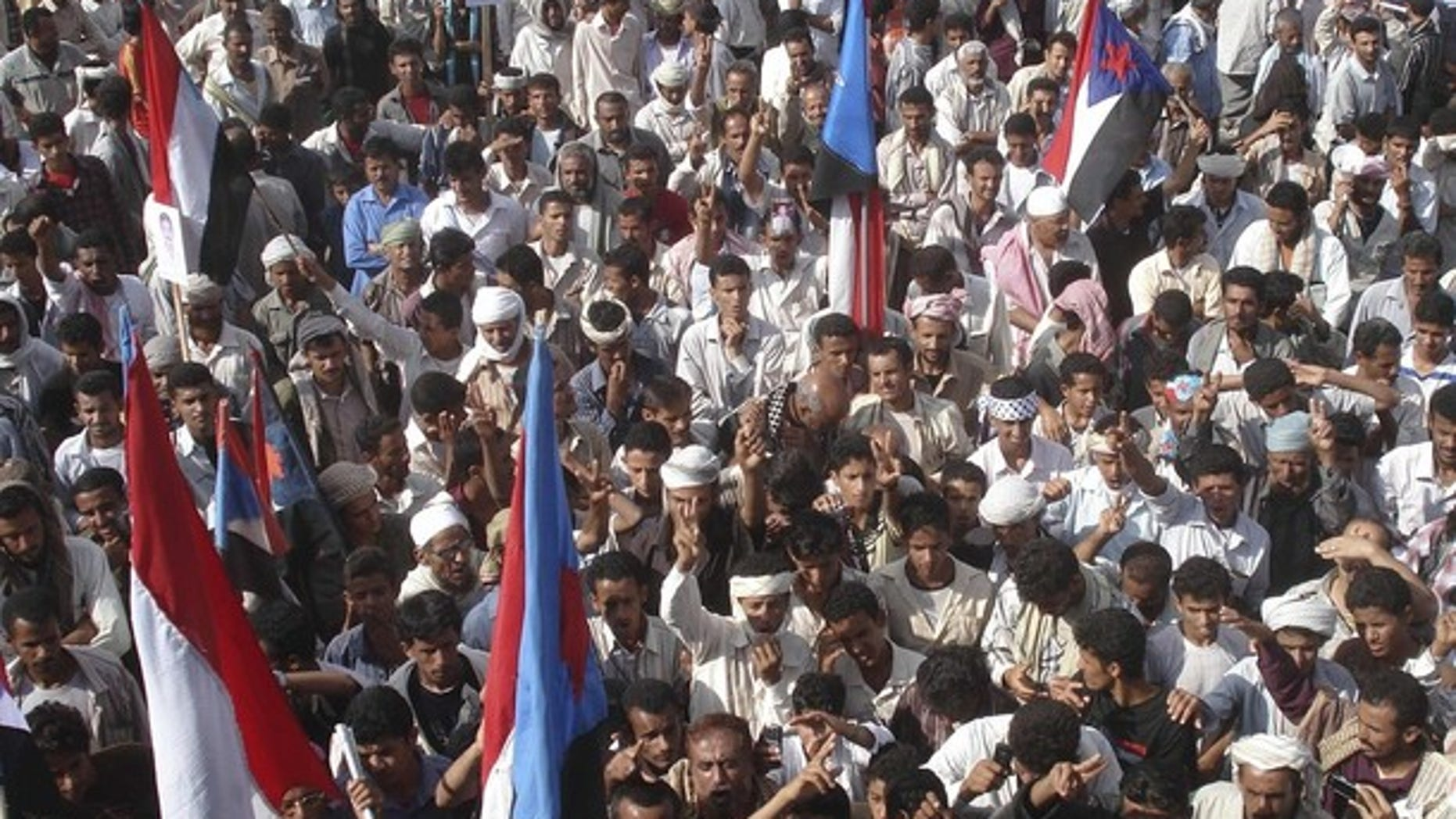 Dec. 17: Protesters wave flags of former South Yemen as they shout slogans during anti-government rallies organized by the Southern Movement to demand southern Yemen secede from the northern half (Reuters).
