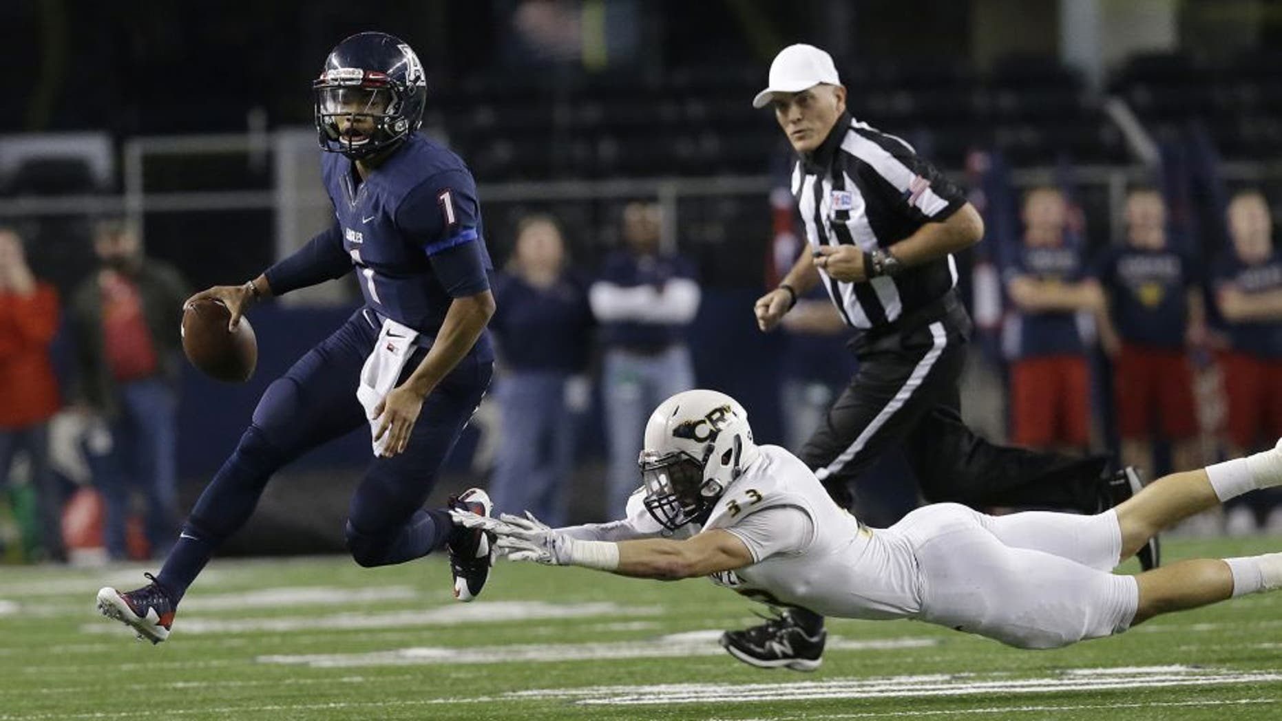 Allen quarterback Kyler Murray (1) eludes Cypress Ranch linebacker Brayden Stringer (33) during the first half of the UIL 6A Division I state championship football game Saturday, Dec. 20, 2014, in Arlington, Texas. (AP Photo/LM Otero)