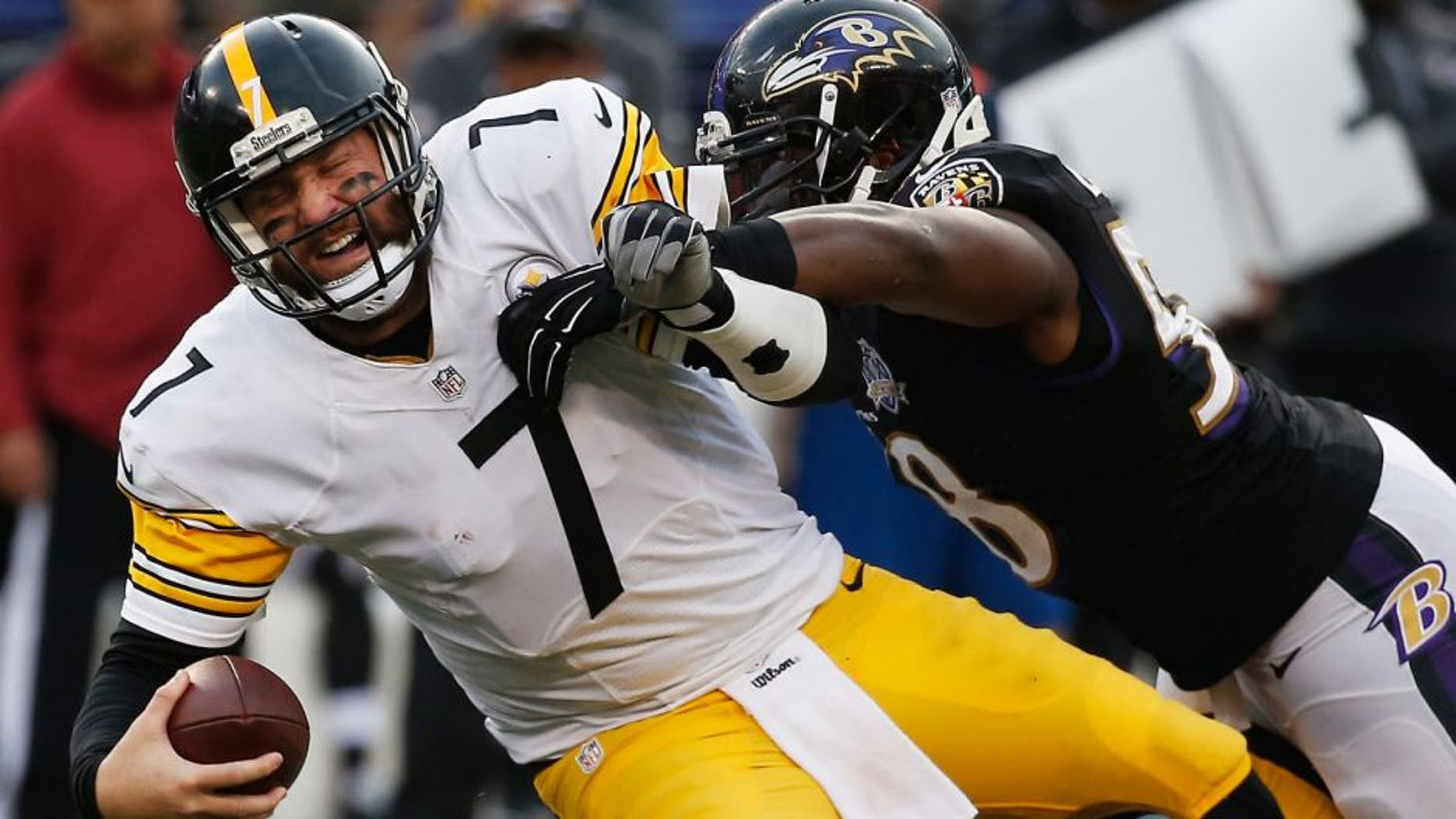 BALTIMORE, MD - DECEMBER 27: Ben Roethlisberger #7 of the Pittsburgh Steelers is sacked by Elvis Dumervil #58 of the Baltimore Ravens during the fourth quarter at M&T Bank Stadium on December 27, 2015 in Baltimore, Maryland. (Photo by Rob Carr/Getty Images)