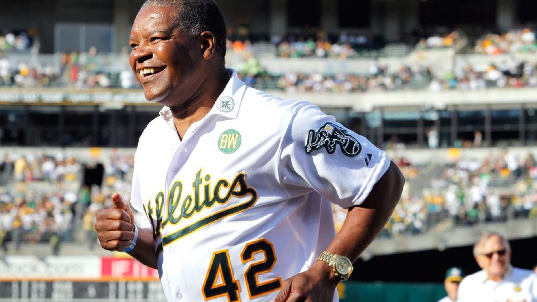 OAKLAND, CA - JULY 19: Dave Henderson #42 of the 1989 Oakland A's joins his teammates as they celebrate their World Series championship 25 years ago against the San Francisco Giants before a game at O.co Coliseum on July 19, 2014 in Oakland, California. (Photo by Brian Bahr/Getty Images)