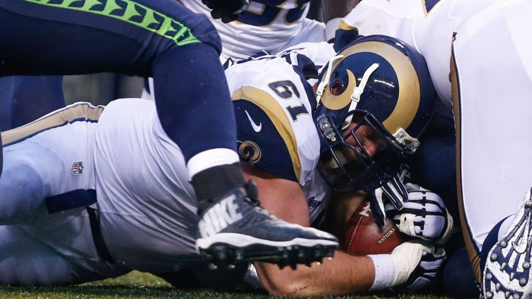 Dec 27, 2015; Seattle, WA, USA; St. Louis Rams center Tim Barnes (61) recovers a fumble against the Seattle Seahawks during the fourth quarter at CenturyLink Field. Mandatory Credit: Joe Nicholson-USA TODAY Sports