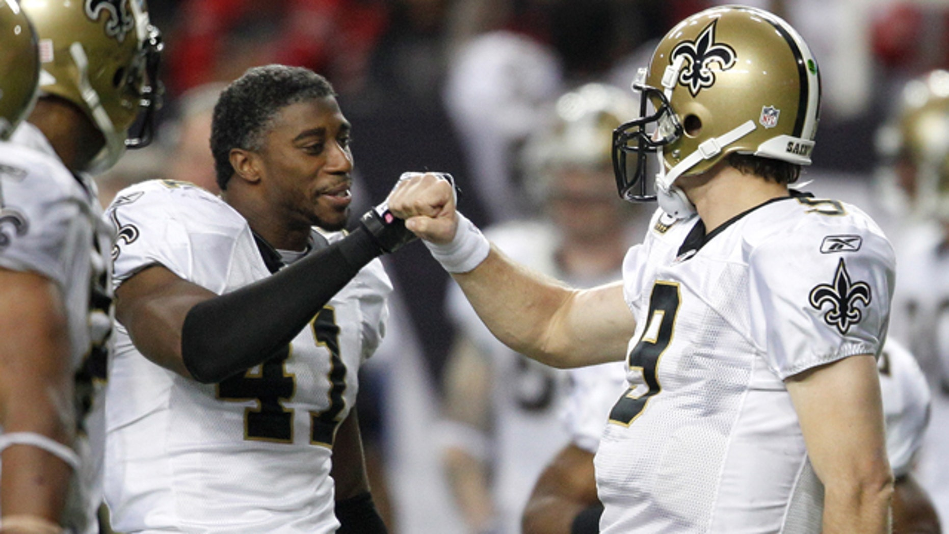 New Orleans Saints quarterback Drew Brees, right, celebrates with Roman Harper (41) in the final seconds of an NFL football game against the Atlanta Falcons on Monday, Dec. 27, 2010, in Atlanta. New Orleans won 17-14. (AP Photo/David Goldman)