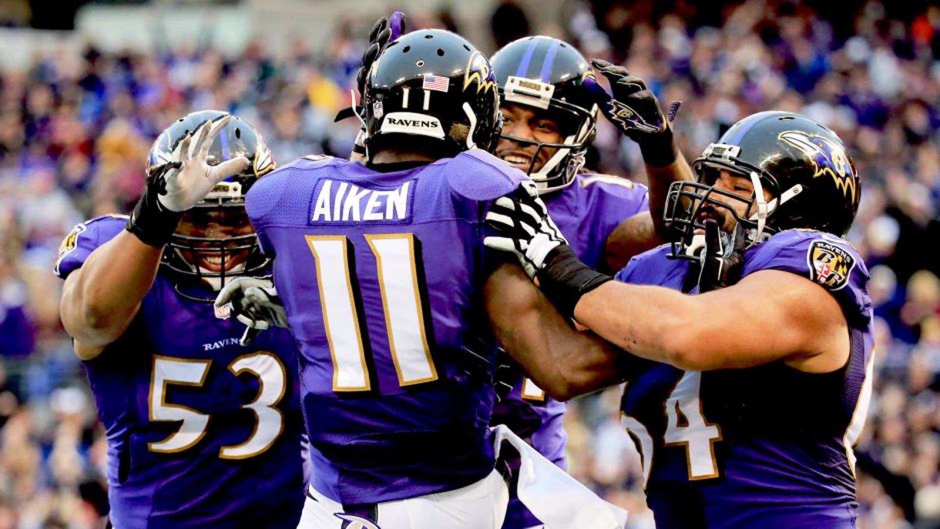 BALTIMORE, MD - DECEMBER 28: Wide receiver Kamar Aiken #11 of the Baltimore Ravens celebrates with teammates after catching a fourth quarter touchdown against the Cleveland Browns at M&T Bank Stadium on December 28, 2014 in Baltimore, Maryland. (Photo by Rob Carr/Getty Images)