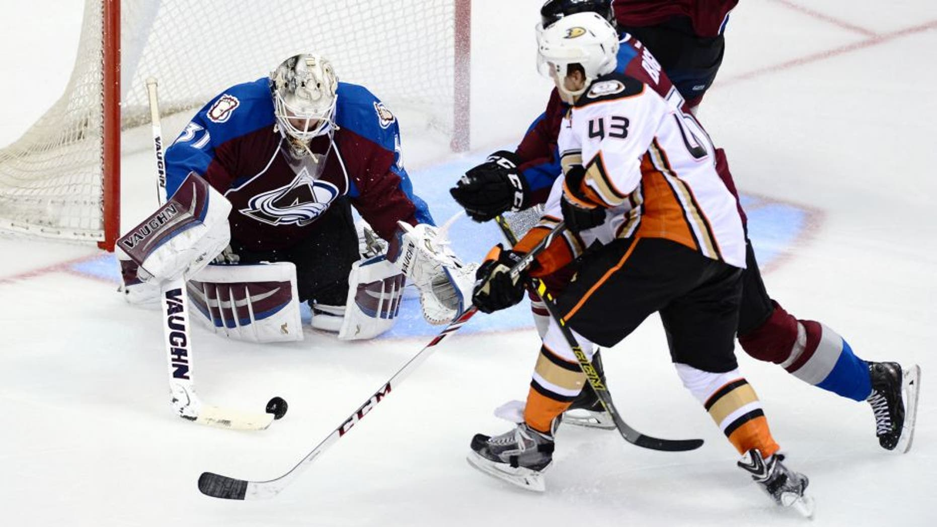 Sep 22, 2014; Denver, CO, USA; Colorado Avalanche goalie Calvin Pickard (31) makes a save on Anaheim Ducks left wing Max Friberg (43) as defenseman Chris Bigras (57) assists in defense in the second period at Pepsi Center. Mandatory Credit: Ron Chenoy-USA TODAY Sports