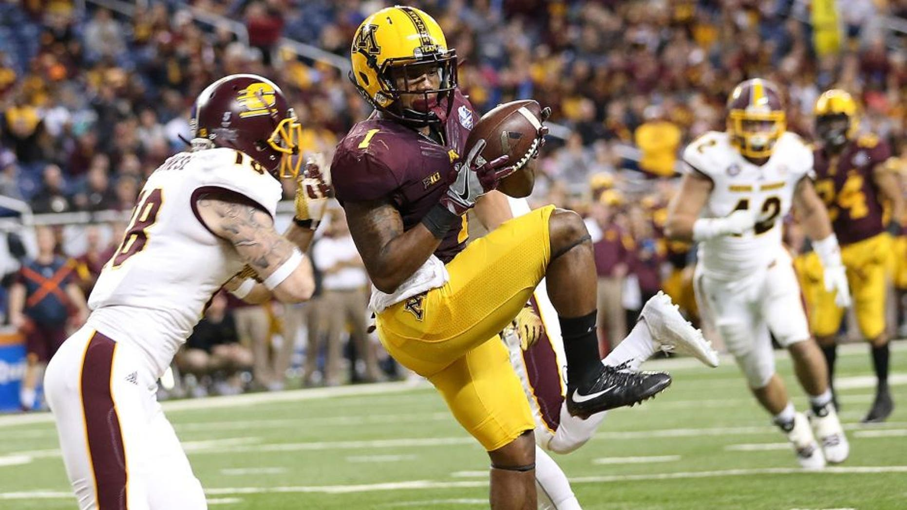 DETROIT MI - DECEMBER 28: KJ Maye #1 of the Minnesota Golden Gophers makes the catch for a touchdown during the second quarter of the game over Tony Annese #18 of the Central Michigan Chippewas on December 28, 2015 during the Quick Lane Bowl at Ford Field in Detroit, Michigan. (Photo by Leon Halip/Getty Images)