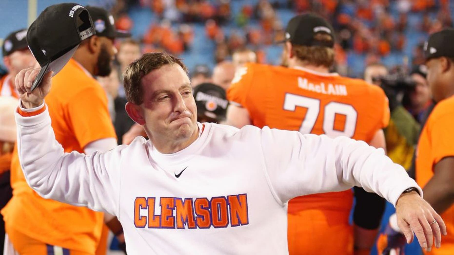 Head coach Dabo Swinney of the Clemson Tigers celebrates after defeating the North Carolina Tar Heels 45-37 at the Atlantic Coast Conference Football Championship at Bank of America Stadium on December 5, 2015 in Charlotte, North Carolina. (Photo by Streeter Lecka/Getty Images)
