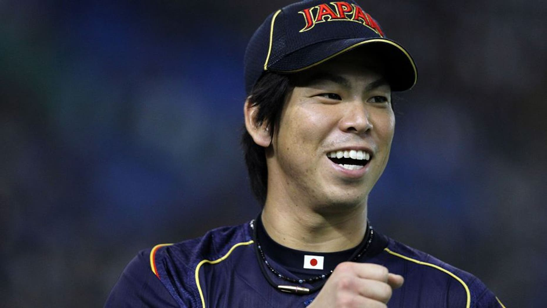 TOKYO, JAPAN - MARCH 10: Pitcher Kenta Maeda #20 of Japan celebrates after in the bottom half of the second inning during the World Baseball Classic Second Round Pool 1 game between Japan and the Netherlands at Tokyo Dome on March 10, 2013 in Tokyo, Japan. (Photo by Koji Watanabe/Getty Images)