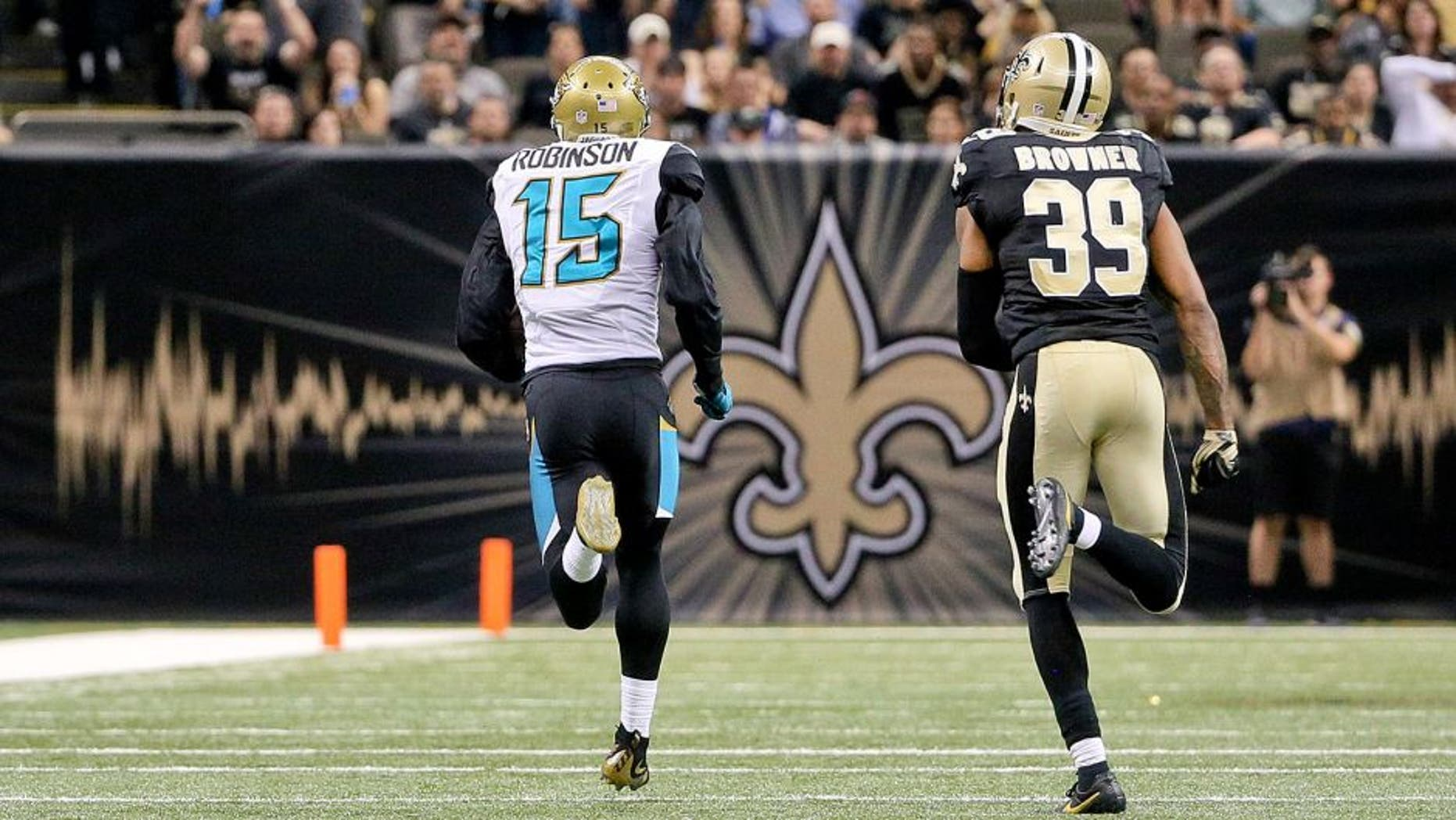 Dec 27, 2015; New Orleans, LA, USA; Jacksonville Jaguars wide receiver Allen Robinson (15) catches a touchdown over New Orleans Saints cornerback Brandon Browner (39) during the second half of a game at the Mercedes-Benz Superdome. The Saints defeated the Jaguars 38-27. Mandatory Credit: Derick E. Hingle-USA TODAY Sports