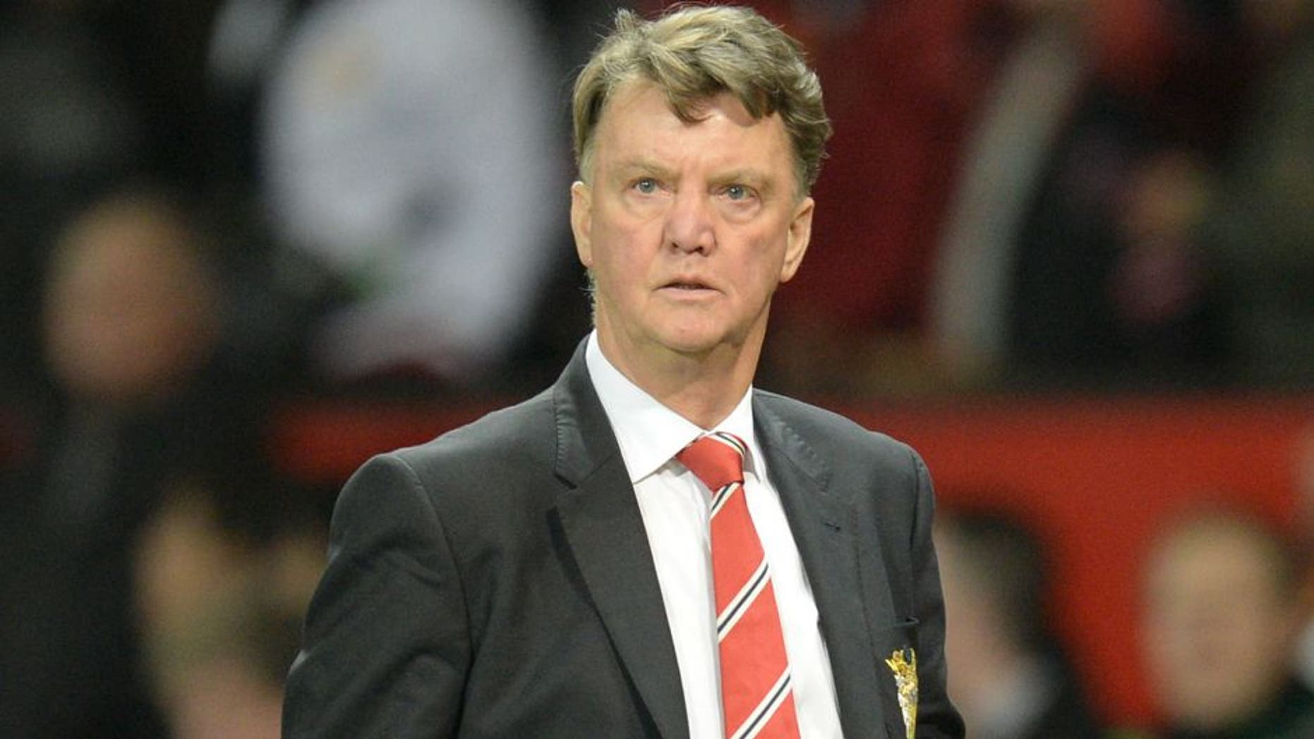 Manchester United's Dutch manager Louis van Gaal leaves the pitch after the final whistle of the English Premier League football match between Manchester United and Chelsea at Old Trafford in Manchester, north west England, on December 28, 2015. AFP PHOTO / OLI SCARFF RESTRICTED TO EDITORIAL USE. No use with unauthorized audio, video, data, fixture lists, club/league logos or 'live' services. Online in-match use limited to 75 images, no video emulation. No use in betting, games or single club/league/player publications. / AFP / OLI SCARFF (Photo credit should read OLI SCARFF/AFP/Getty Images)