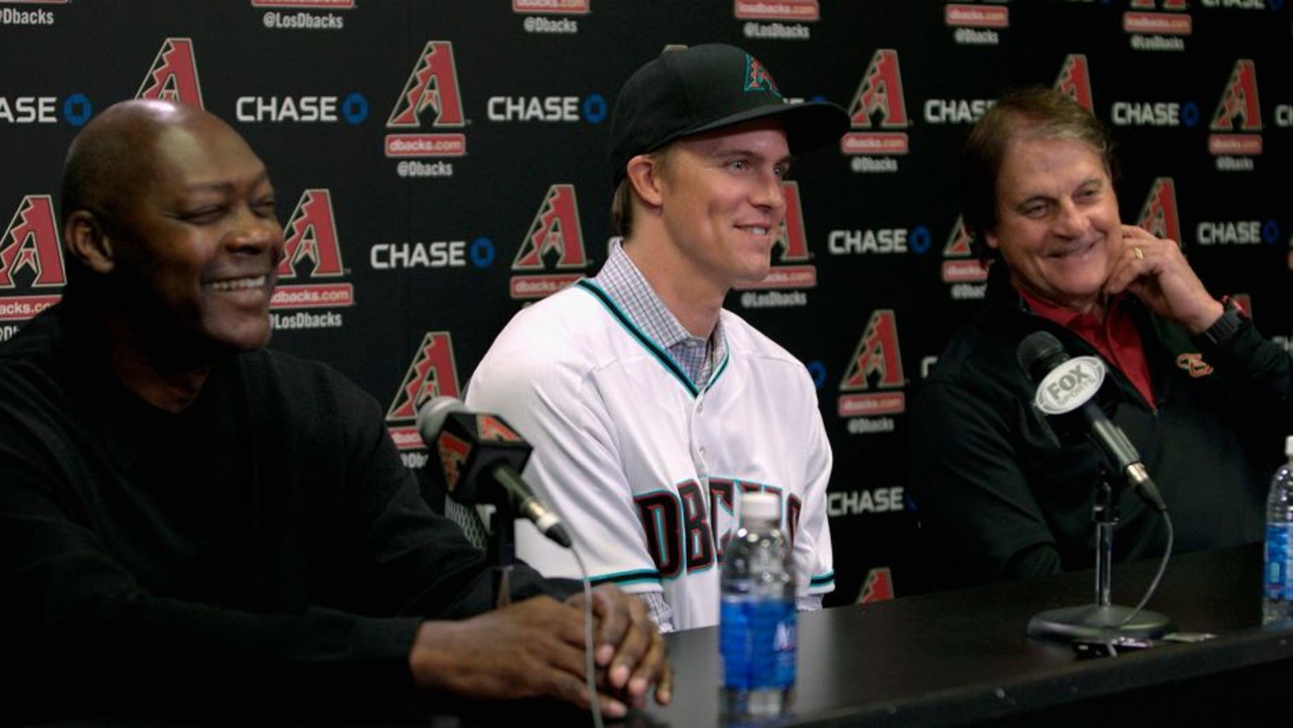 PHOENIX, AZ - DECEMBER 11: Free agent aquisition Zack Greinke of the Arizona Diamondbacks (C) laughs with Chief Baseball Officer Tony La Russa (R) and General Manager Dave Stewart during a press conference at Chase Field on December 11, 2015 in Phoenix, Arizona. (Photo by Ralph Freso/Getty Images)