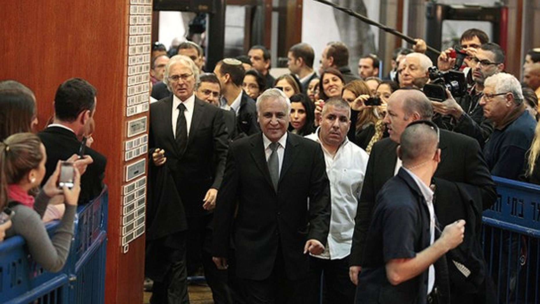 Dec. 30: Israel's former president Moshe Katsav (C) arrives at Tel Aviv District Court to hear the verdict on charges of rape and sexual misconduct against him.