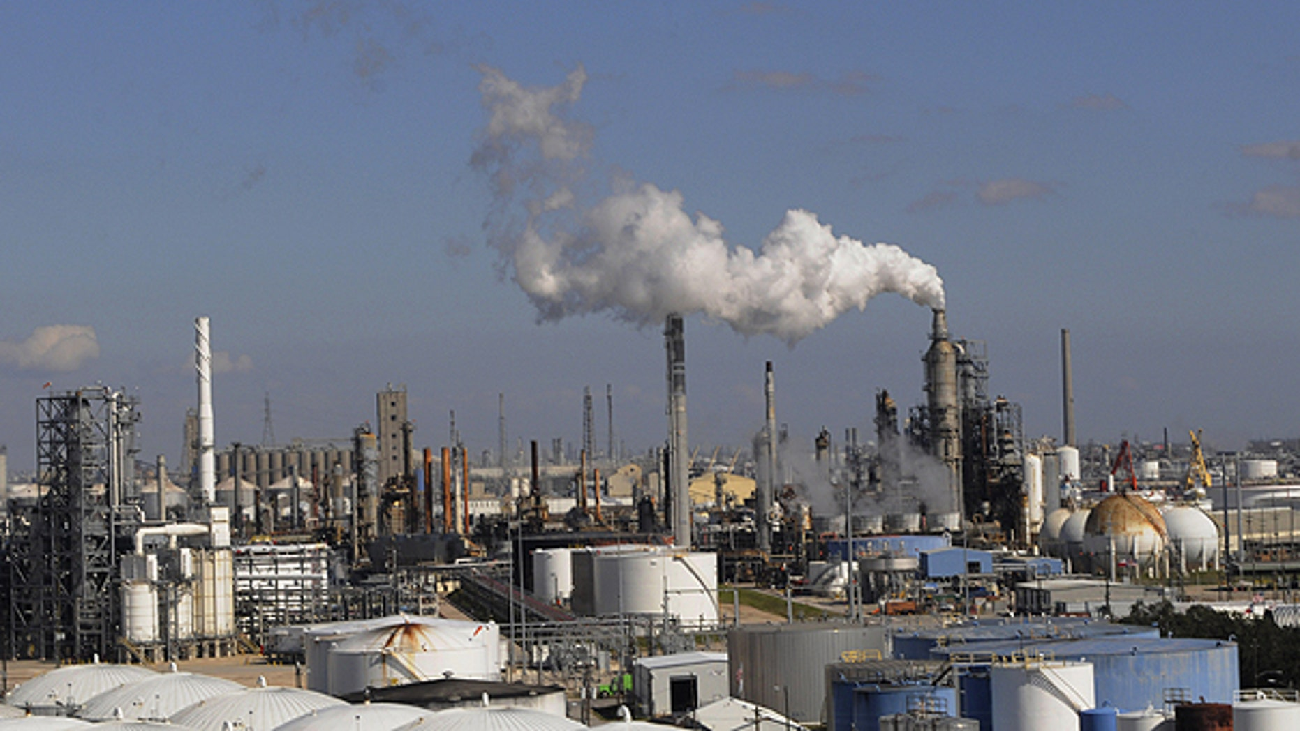 n this Feb. 25, 2010 file photo, refineries and chemical plants release steam near the Houston ship channel.