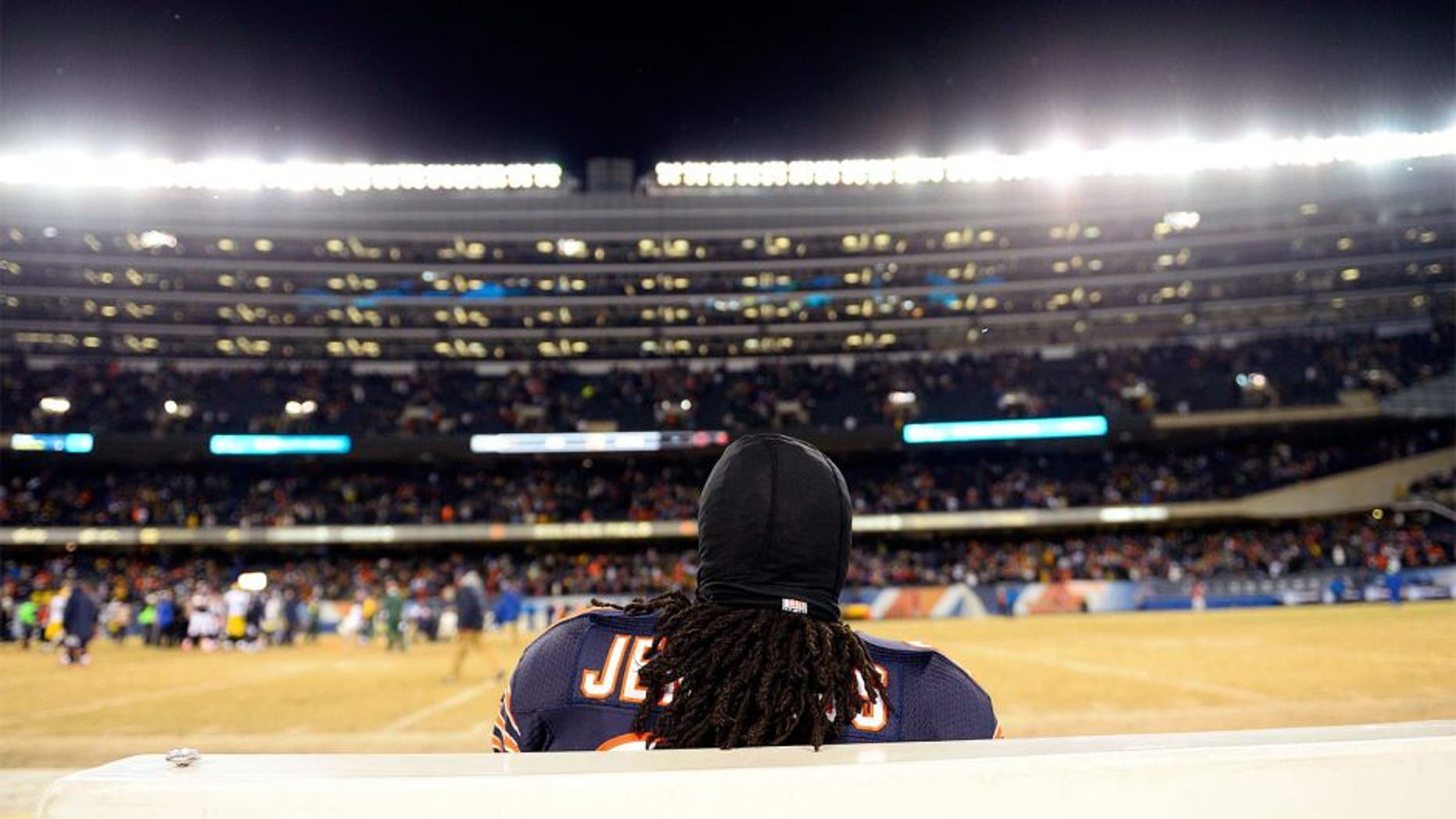 Dec 29, 2013; Chicago, IL, USA; Chicago Bears cornerback Tim Jennings (26) sits on the bench after the game against the Green Bay Packers at Soldier Field. The Green Bay Packers win 33-28. Mandatory Credit: Mike DiNovo-USA TODAY Sports