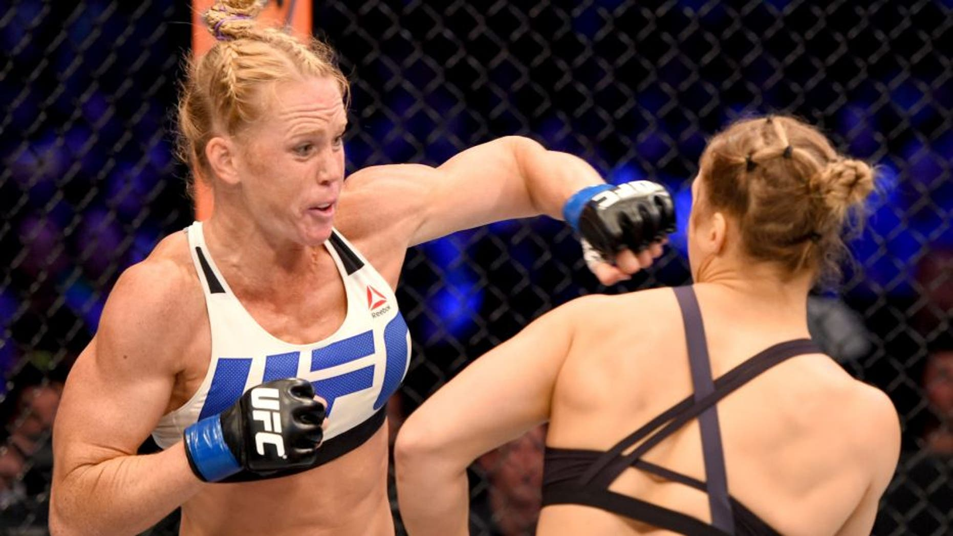 MELBOURNE, AUSTRALIA - NOVEMBER 15: (L-R) Holly Holm of the United States punches Ronda Rousey of the United States in their UFC women's bantamweight championship bout during the UFC 193 event at Etihad Stadium on November 15, 2015 in Melbourne, Australia. (Photo by Josh Hedges/Zuffa LLC/Zuffa LLC via Getty Images)
