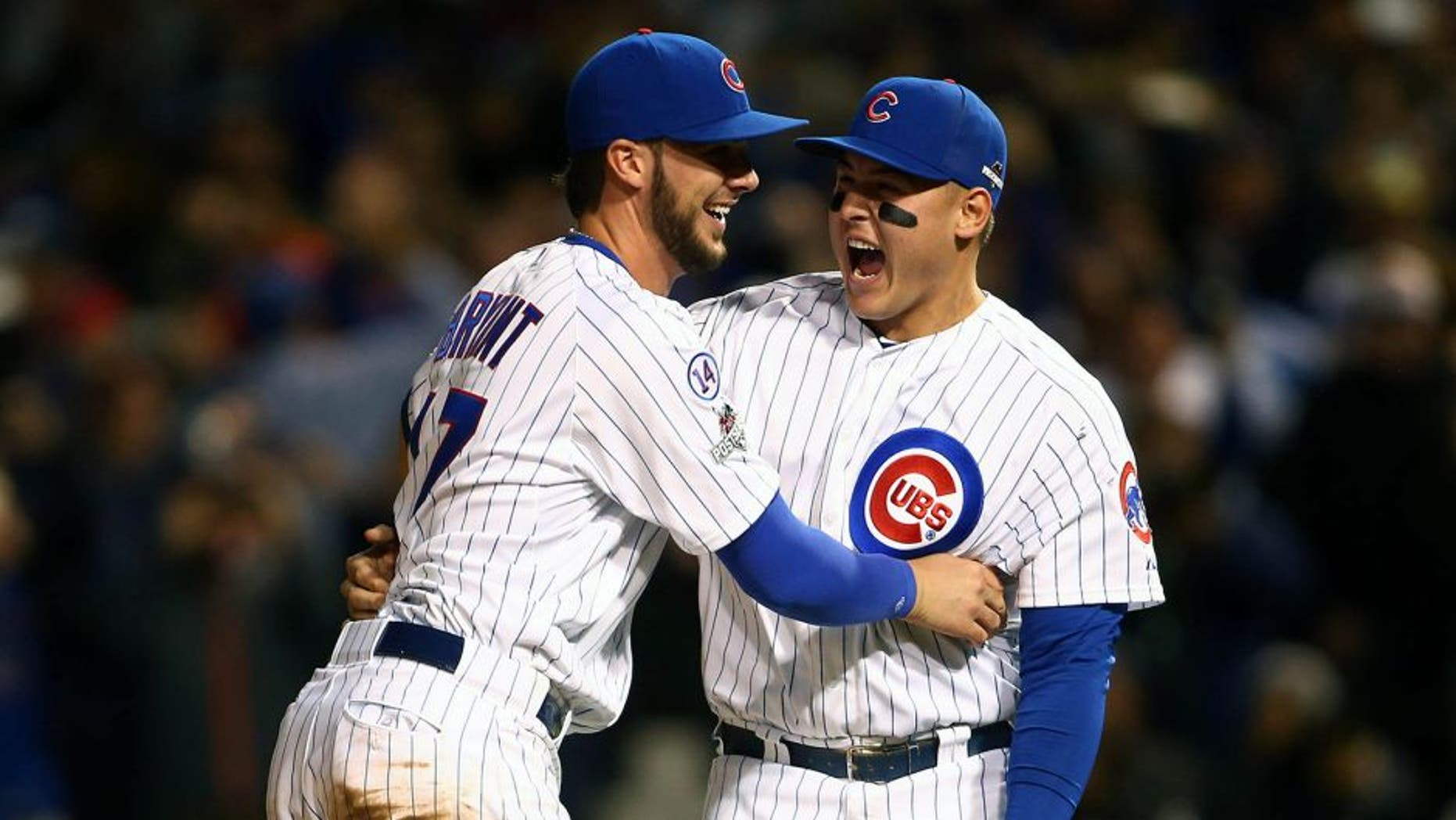 October 13, 2015; Chicago, IL, USA; Chicago Cubs third baseman Kris Bryant (17) and first baseman Anthony Rizzo (44) celebrate the 6-4 victory and against St. Louis Cardinals in game four of the NLDS at Wrigley Field. Mandatory Credit: Jerry Lai-USA TODAY Sports