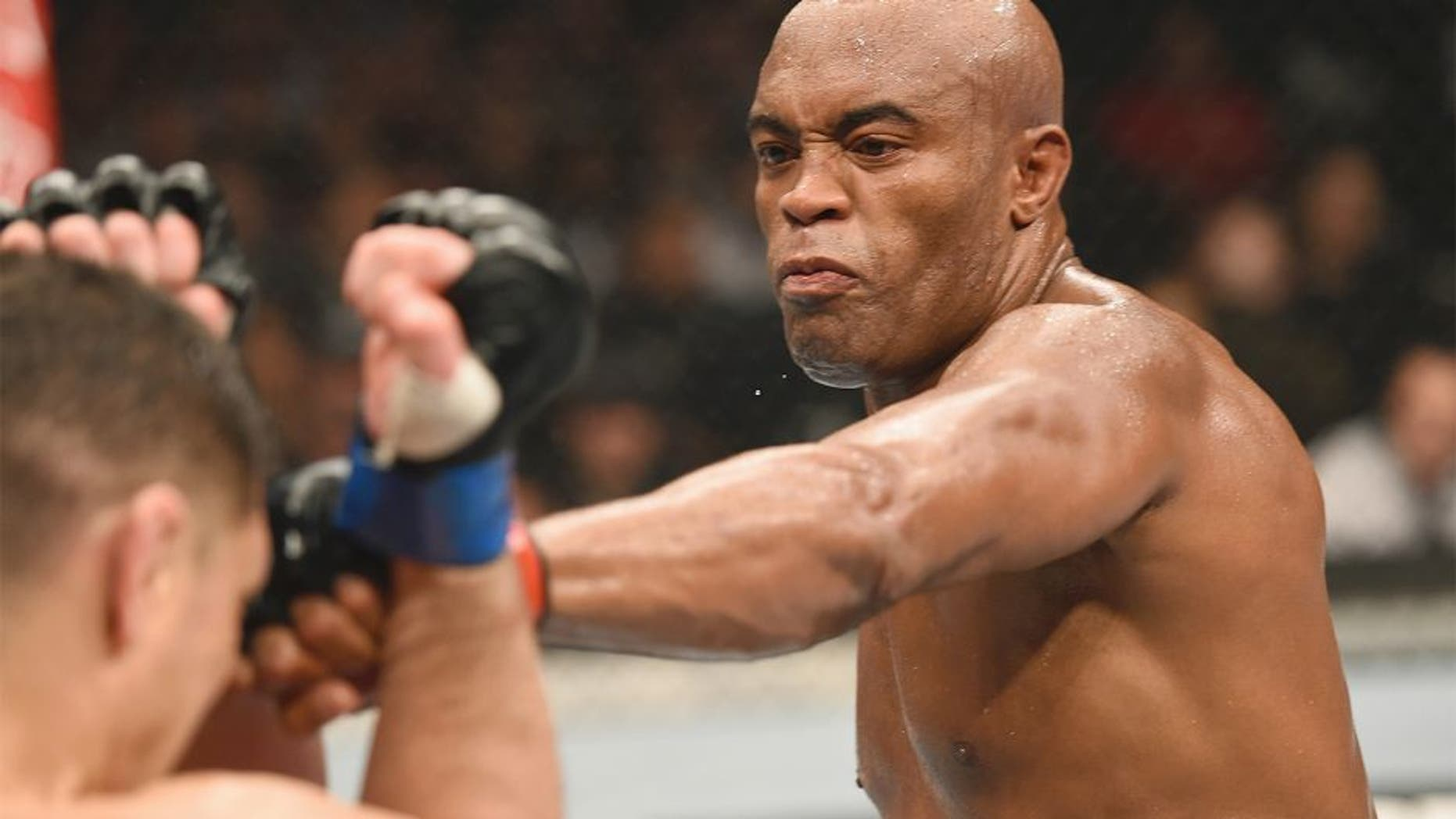 LAS VEGAS, NV - JANUARY 31: (R-L) Anderson Silva punches Nick Diaz in their middleweight bout during the UFC 183 event at the MGM Grand Garden Arena on January 31, 2015 in Las Vegas, Nevada. (Photo by Josh Hedges/Zuffa LLC/Zuffa LLC via Getty Images)