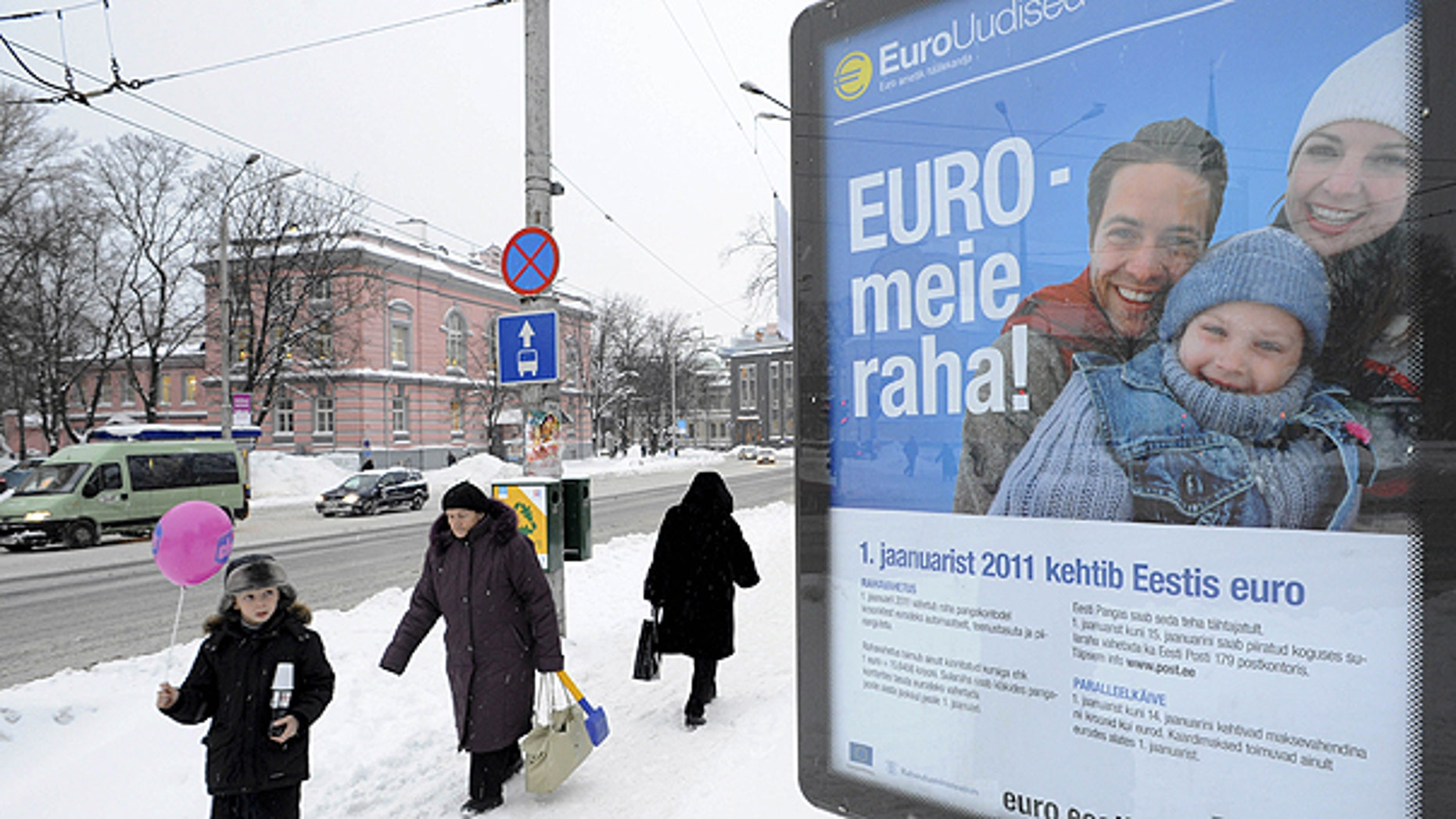 Dec. 27: People pass by a poster saying 'Euro is our money' in Tallinn, Estonia.