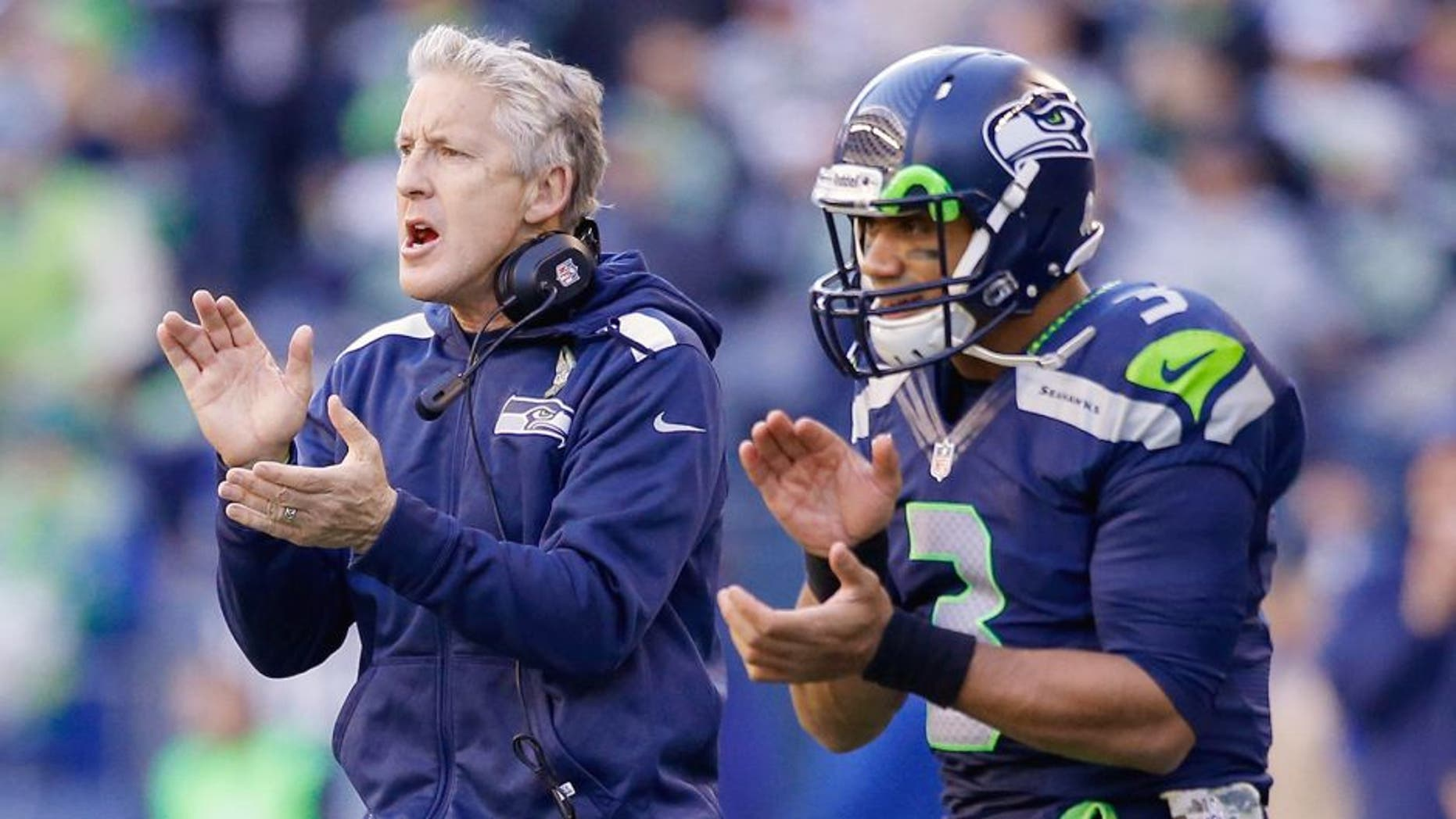 SEATTLE, WA - NOVEMBER 17: Head coach Pete Carroll and quarterback Russell Wilson #3 of the Seattle Seahawks react to a point after touchdown against the Minnesota Vikings at CenturyLink Field on November 17, 2013 in Seattle, Washington. (Photo by Otto Greule Jr/Getty Images)