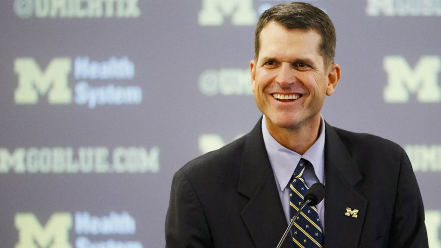 Dec 30, 2014; Ann Arbor, MI, USA; Jim Harbaugh speaks to the media as he is introduced as the new head football coach of the Michigan Wolverines at Jonge Center. Mandatory Credit: Rick Osentoski-USA TODAY Sports
