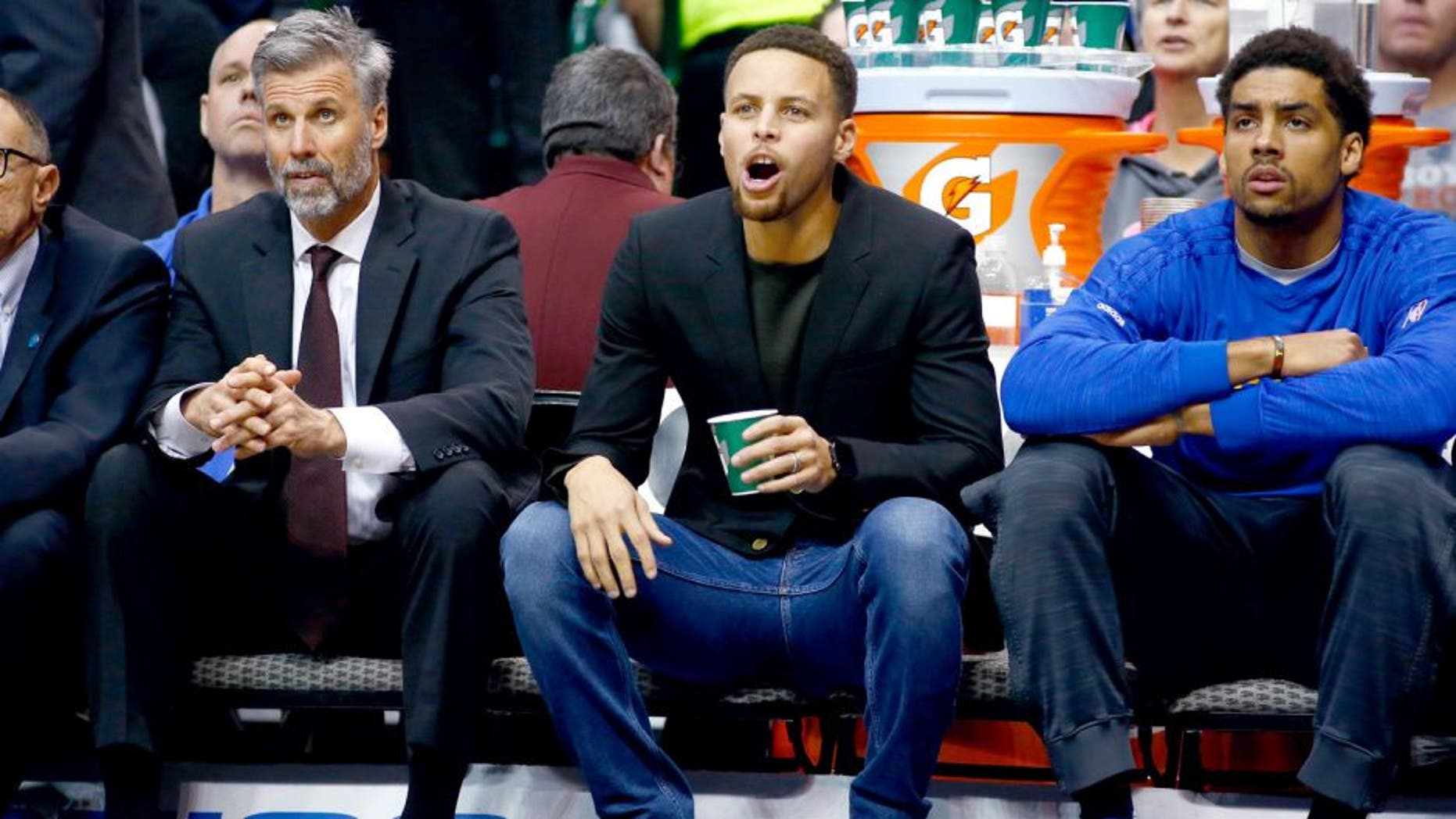 DALLAS, TX - DECEMBER 30: Stephen Curry #30 of the Golden State Warriors yells while on the bench during a game against the Dallas Mavericks at American Airlines Center on December 30, 2015 in Dallas, Texas. NOTE TO USER: User expressly acknowledges and agrees that, by downloading and or using photograph, User is consenting to the terms and conditions of the Getty Images License Agreement. (Photo by Ronald Martinez/Getty Images)