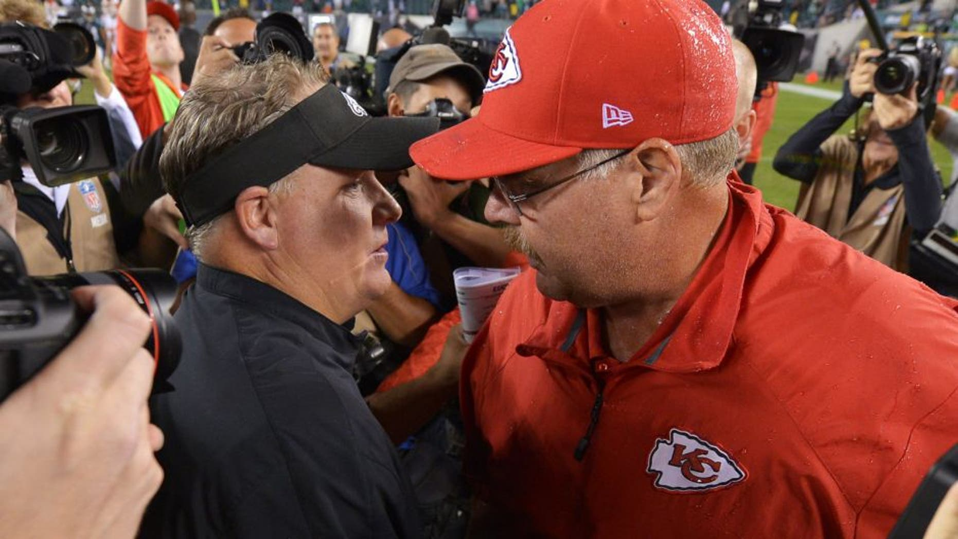 PHILADELPHIA, PA - SEPTEMBER 19: Head coach Chip Kelly of the Philadelphia Eagles and head coach Andy Reid of the Kansas City Chiefs shake hands after the game at Lincoln Financial Field on September 19, 2013 in Philadelphia, Pennsylvania. The Chiefs won 26-16. (Photo by Drew Hallowell/Philadelphia Eagles/Getty Images)