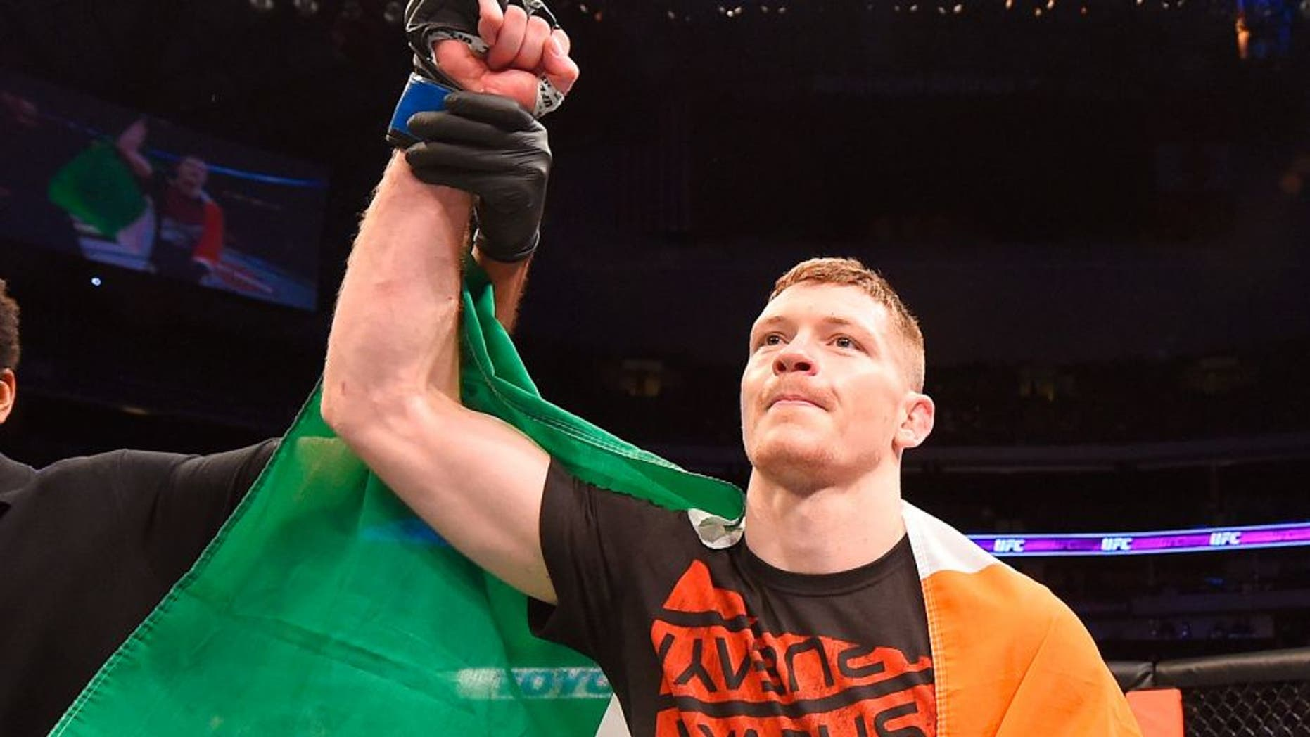 DALLAS, TX - MARCH 14: Joseph Duffy celebrates after defeating Jake Lindsey in their lightweight bout during the UFC 185 event at the American Airlines Center on March 14, 2015 in Dallas, Texas. (Photo by Josh Hedges/Zuffa LLC/Zuffa LLC via Getty Images)
