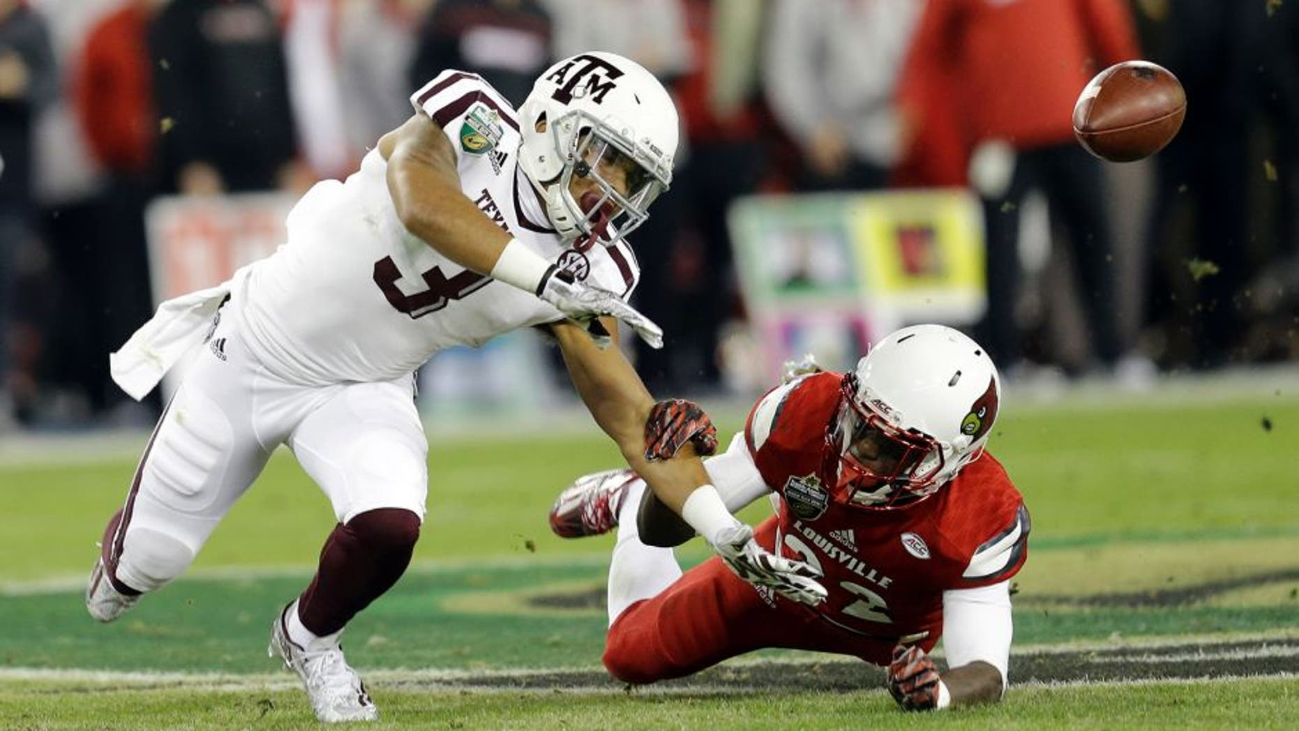 Louisville safety Chucky Williams, right, breaks up a pass intended for Texas A&M wide receiver Christian Kirk (3) in the first half of the Music City Bowl NCAA college football game Wednesday, Dec. 30, 2015, in Nashville, Tenn. (AP Photo/Mark Humphrey)