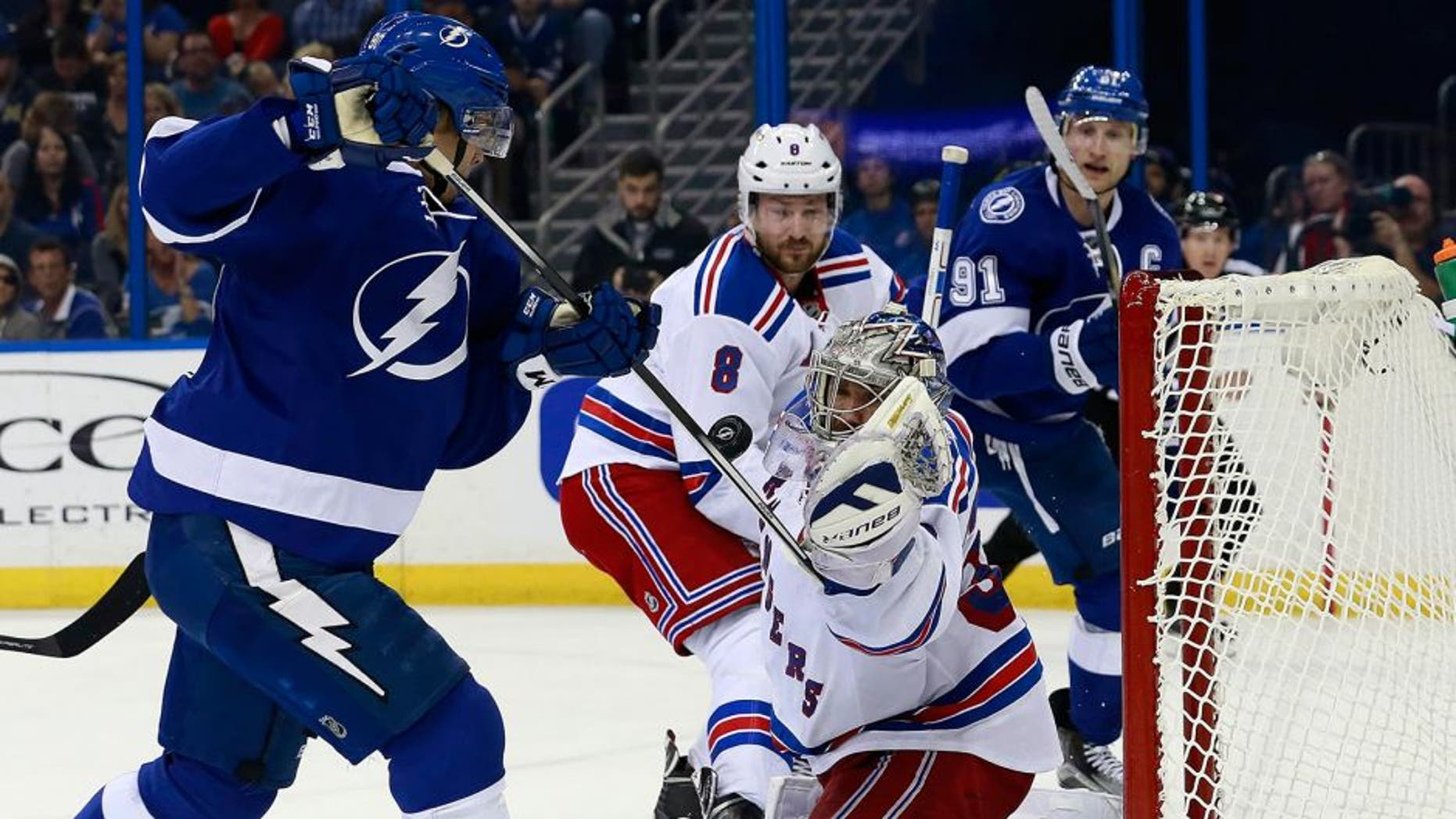 Dec 30, 2015; Tampa, FL, USA; New York Rangers goalie Henrik Lundqvist (30) makes a save from Tampa Bay Lightning center Vladislav Namestnikov (90) during the second period at Amalie Arena. Mandatory Credit: Kim Klement-USA TODAY Sports