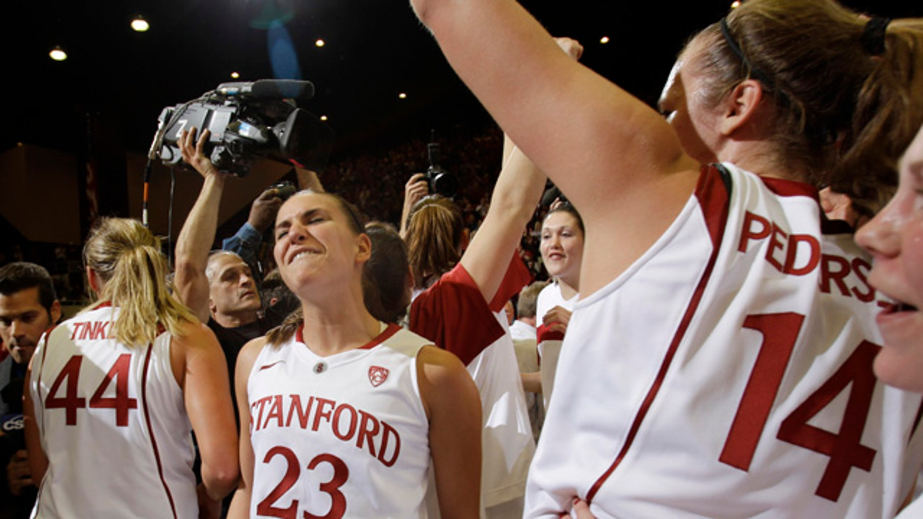 Dec. 30: Stanford guard Jeanette Pohlen (23) celebrates with teammates after Stanford defeated Connecticut 71-59 in an NCAA college basketball game in Stanford, Calif.
