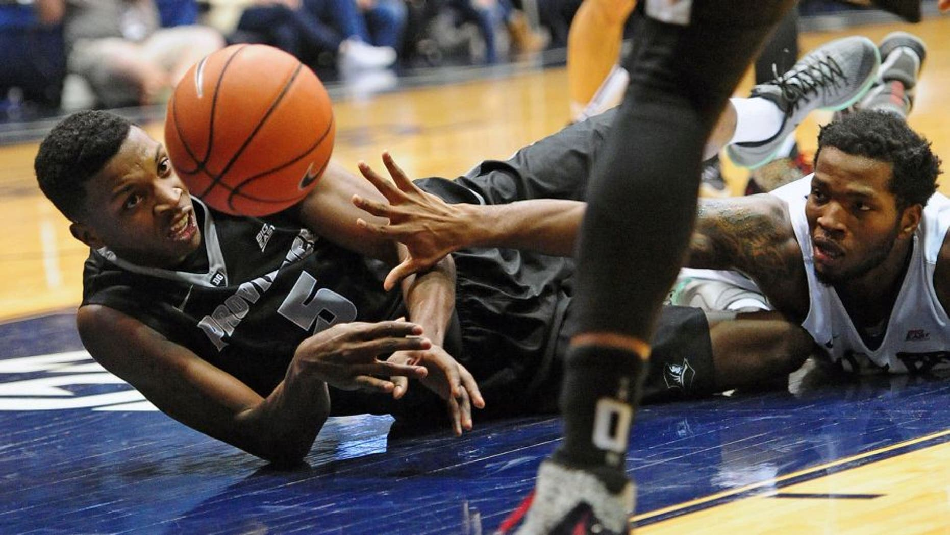 Dec 31, 2015; Indianapolis, IN, USA; Providence College Friars forward Rodney Bullock(5) and Butler University Bulldogs forward Tyler Wideman (4) battle for the ball at Hinkle Fieldhouse. Mandatory Credit: Thomas Joseph-USA TODAY Sports