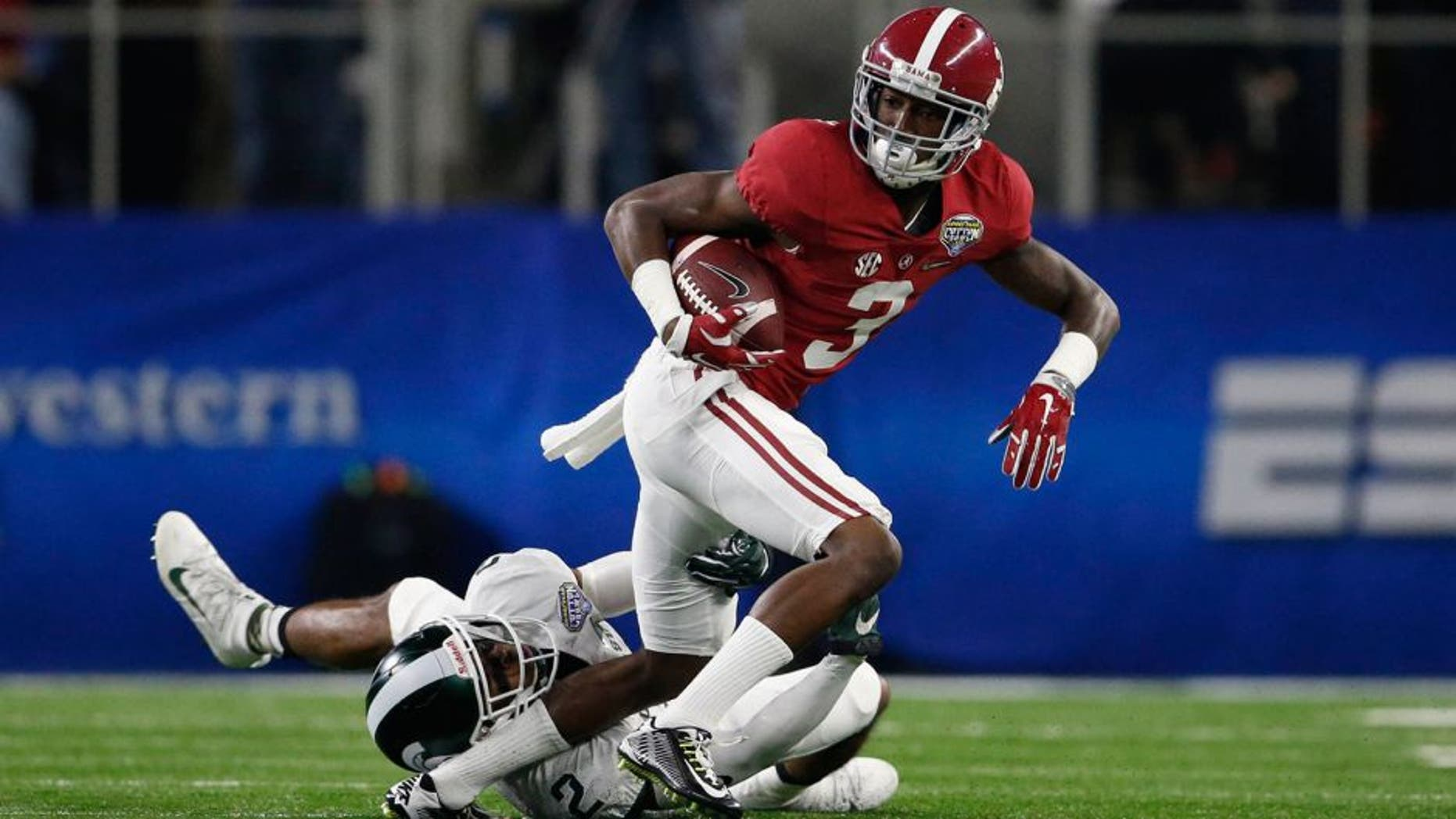 Dec 31, 2015; Arlington, TX, USA; Alabama Crimson Tide wide receiver Calvin Ridley (3) is tackled by Michigan State Spartans cornerback Darian Hicks (2) in the first quarter in the 2015 CFP semifinal at the Cotton Bowl at AT&T Stadium. Mandatory Credit: Matthew Emmons-USA TODAY Sports