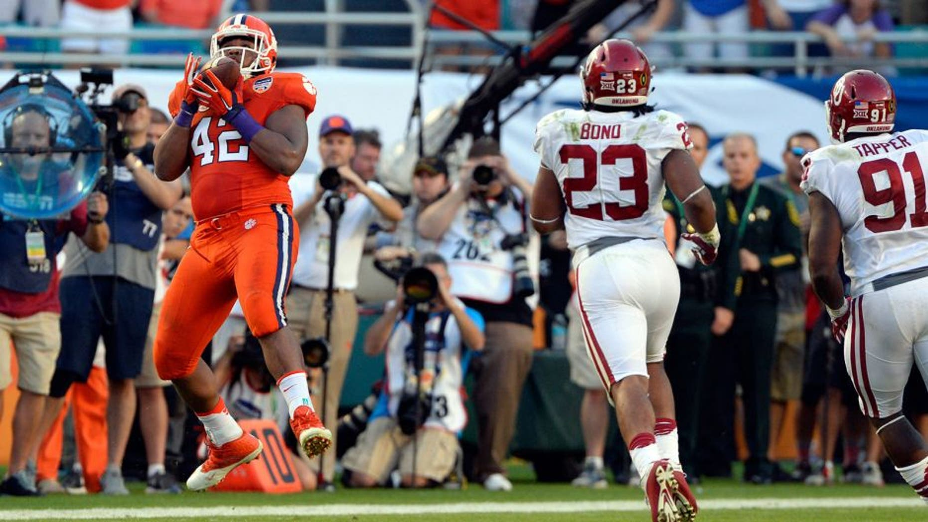 Dec 31, 2015; Miami Gardens, FL, USA; Clemson Tigers defensive lineman Christian Wilkins (42) catches a pass on a fake punt against the Oklahoma Sooners during the first half of the 2015 CFP semifinal at the Orange Bowl at Sun Life Stadium. Mandatory Credit: Tommy Gilligan-USA TODAY Sports