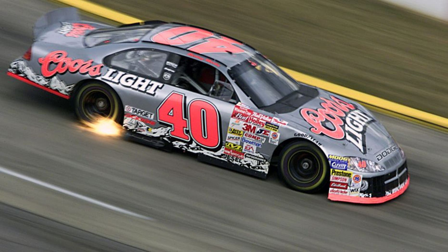 15 Oct 2001: Sterling Marlin catches speed and some fire as he drives the #40 Gnassi Racing Dodge Intrepid R/T during the Old Dominion 500, part of the Winston Cup Nascar Series race at Martinsville Speedway in Martinsville, Virginia. DIGITAL IMAGE Mandatory Credit: Donald Miralle/ALLSPORT