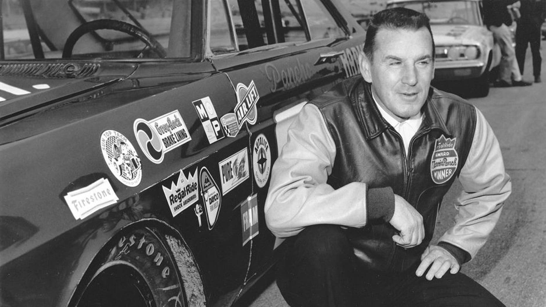 1965: Marvin Panch poses by his Wood Brothers Ford that he drove to four wins during the 1965 NASCAR Cup season. Panch finished fifth in Cup points. (Photo by ISC Images & Archives via Getty Images)