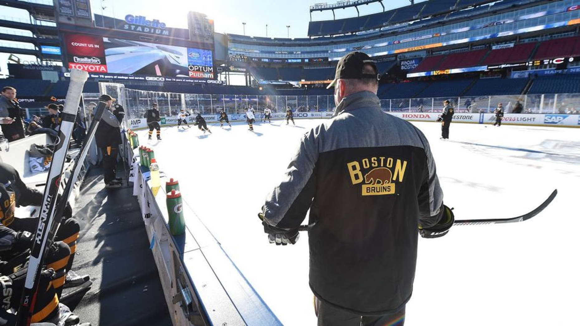 FOXBORO, MA - DECEMBER 31: Head Coach Claude Julien of the Boston Bruins (R) looks on during team practice as part of the 2016 Bridgestone NHL Classic at Gillette Stadium on December 31, 2015 in Foxboro, Massachusetts. The 2016 Bridgestone NHL Winter Classic will take place on New Year's Day with the Montreal Canadiens playing the Boston Bruins. (Photo by Brian Babineau/NHLI via Getty Images)