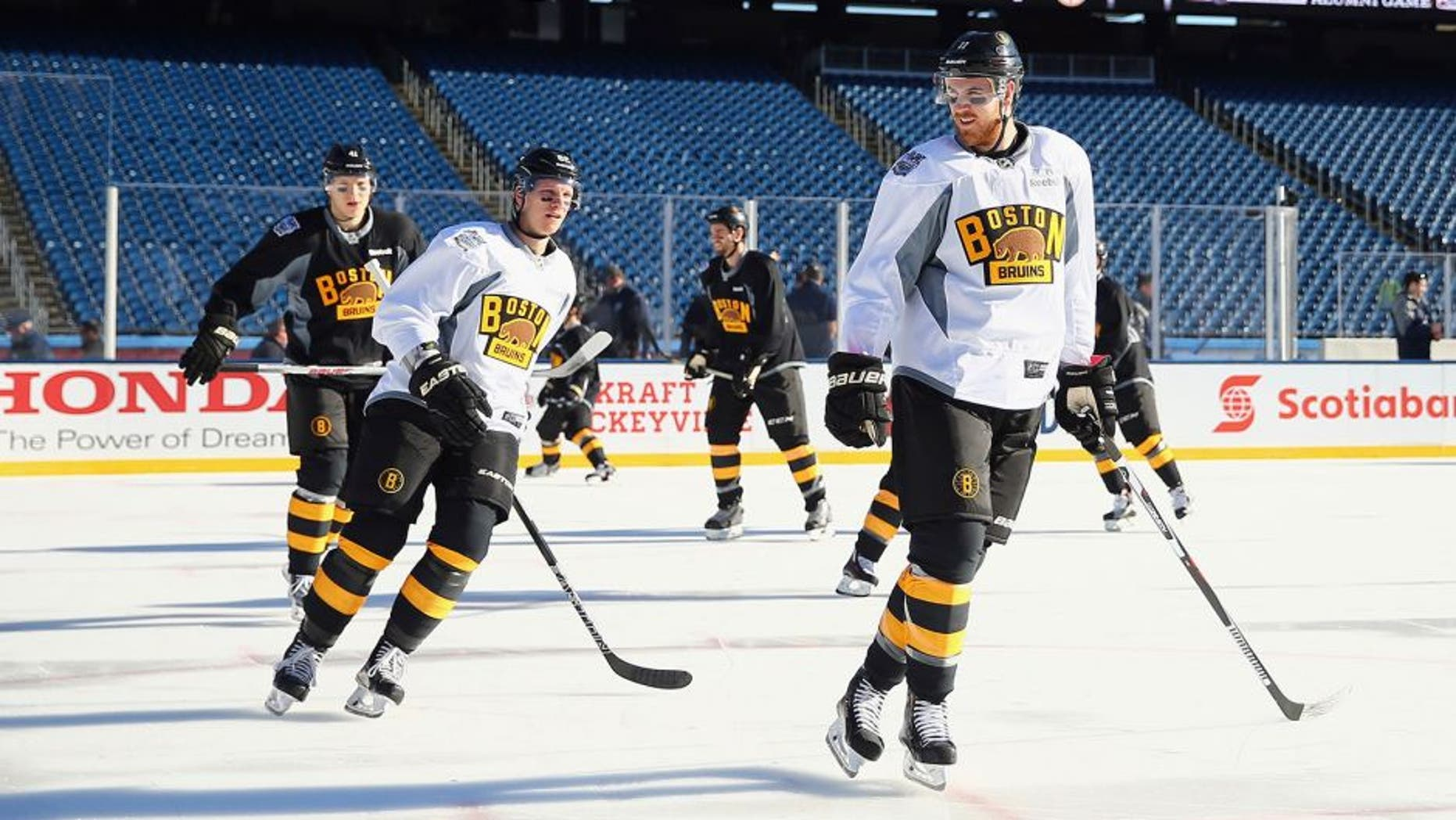 FOXBORO, MA - DECEMBER 31: (l-r) Zach Trotman #62 and Jimmy Hayes #11 of the Boston Bruins skate during the practice session at Gillette Stadium on December 31, 2015 in Foxboro, Massachusetts. (Photo by Maddie Meyer/Getty Images)