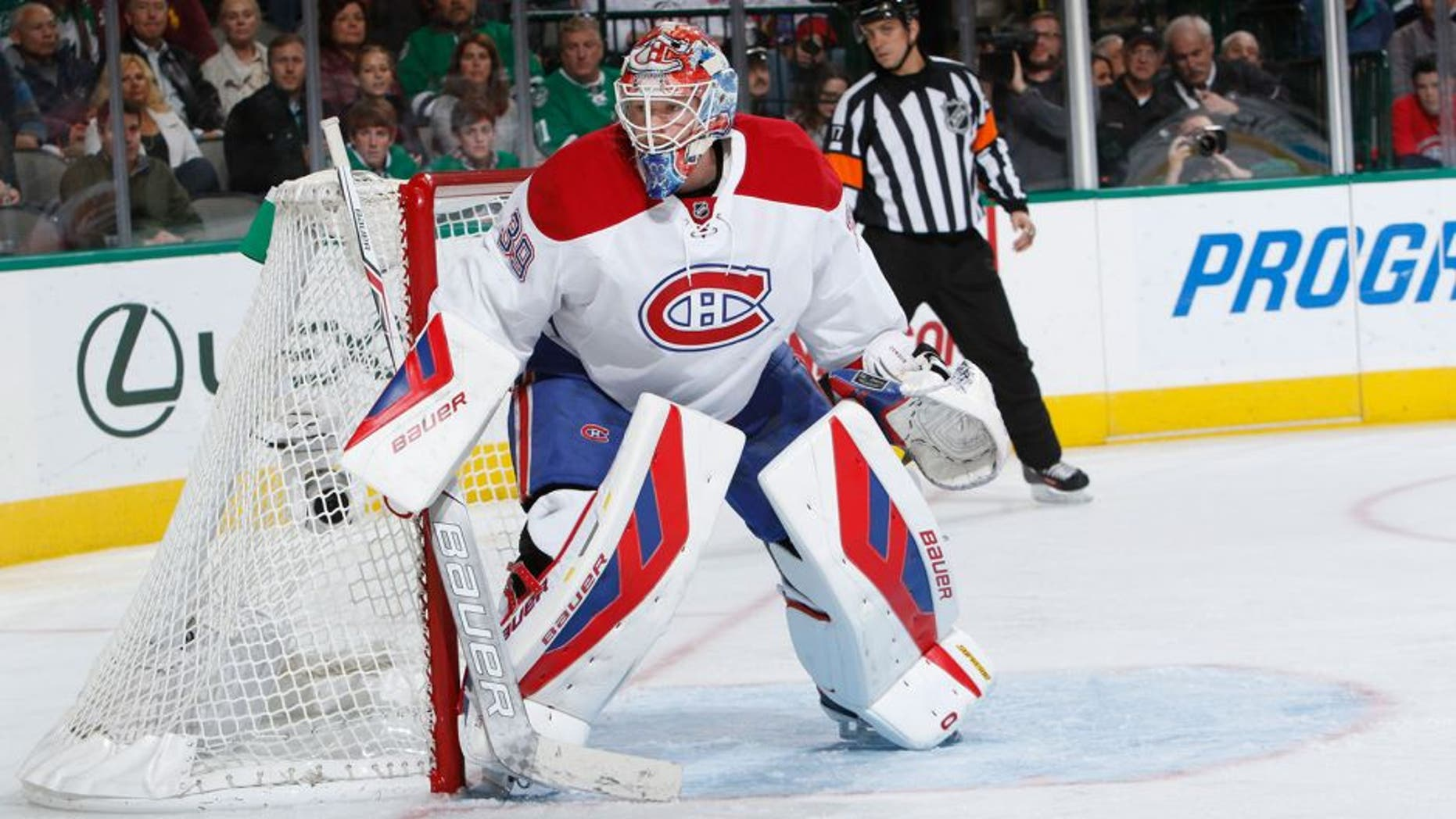 DALLAS, TX - DECEMBER 19: Mike Condon #39 of the Montreal Canadiens waits for the puck against the Dallas Stars at the American Airlines Center on December 19, 2015 in Dallas, Texas. (Photo by Glenn James/NHLI via Getty Images)