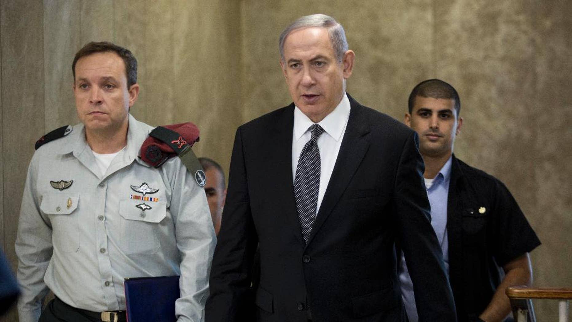 Israeli Prime Minister Benjamin Netanyahu attends the weekly cabinet meeting at his office in Jerusalem, Israel, Sunday, July 17, 2016. (Abir Sultan, Pool via AP)