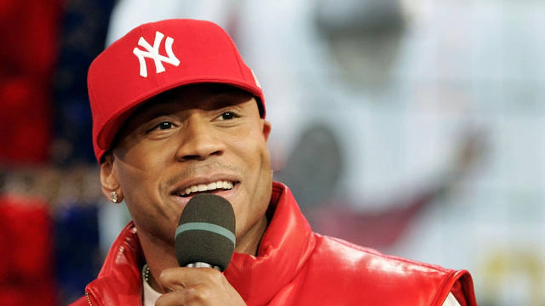 """Actor and Hip Hop artist LL Cool J appears onstage during MTV's """"Total Request Live"""" show at the MTV Time Square Studios, Tuesday, Jan. 10, 2006 in New York City.   (AP Photo/Jeff Christensen)"""