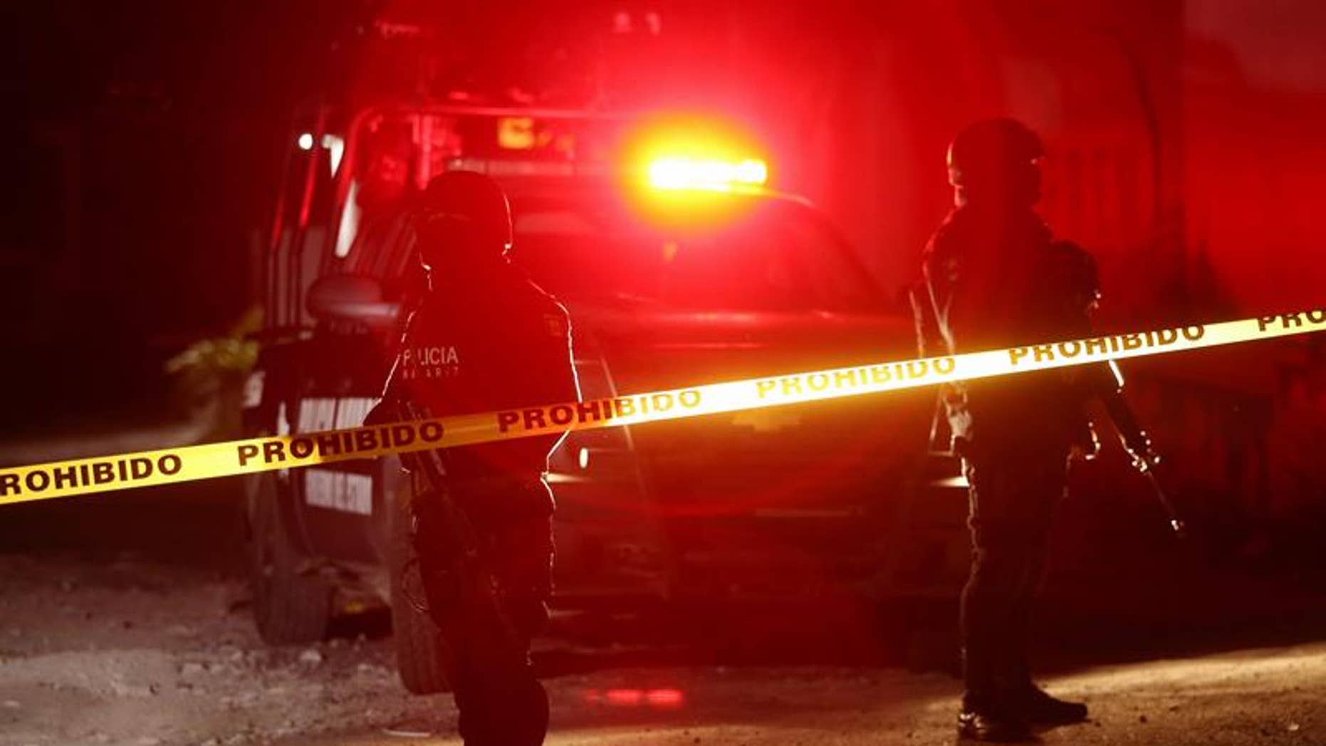 State and federal police on Feb. 10, 2017, guard a crime scene in Tepic, Nayarit where Juan Francisco Padron Sanchez, a suspected regional leader of the Beltran Leyva drug cartel, was killed in a shootout with federal forces.