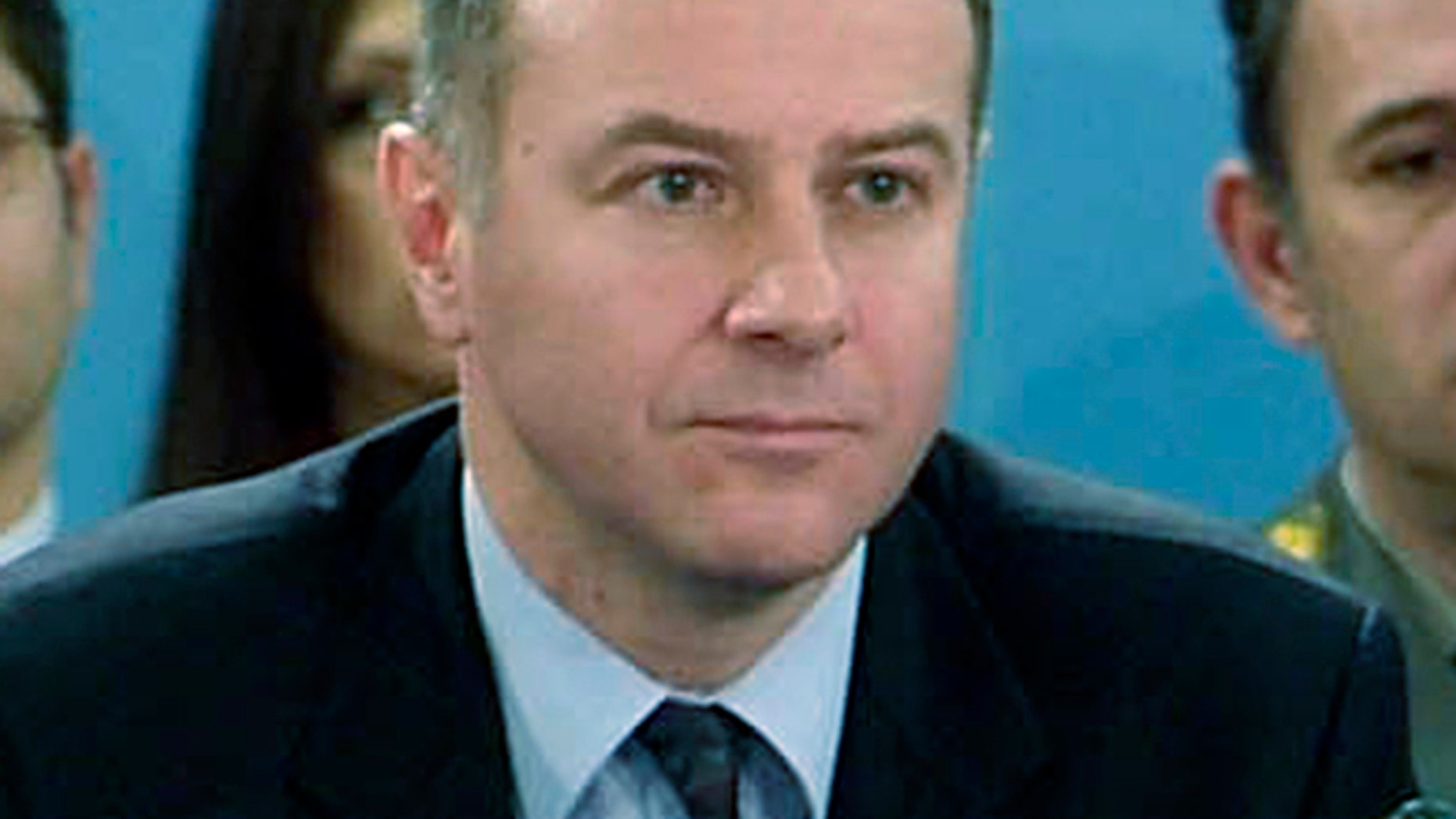 In this photo made available by NATO, in this Dec. 14, 2006 file photo, Serbia's Ambassador to NATO Branislav Milinkovic is seen during a meeting at NATO headquarters in Brussels, Belgium.
