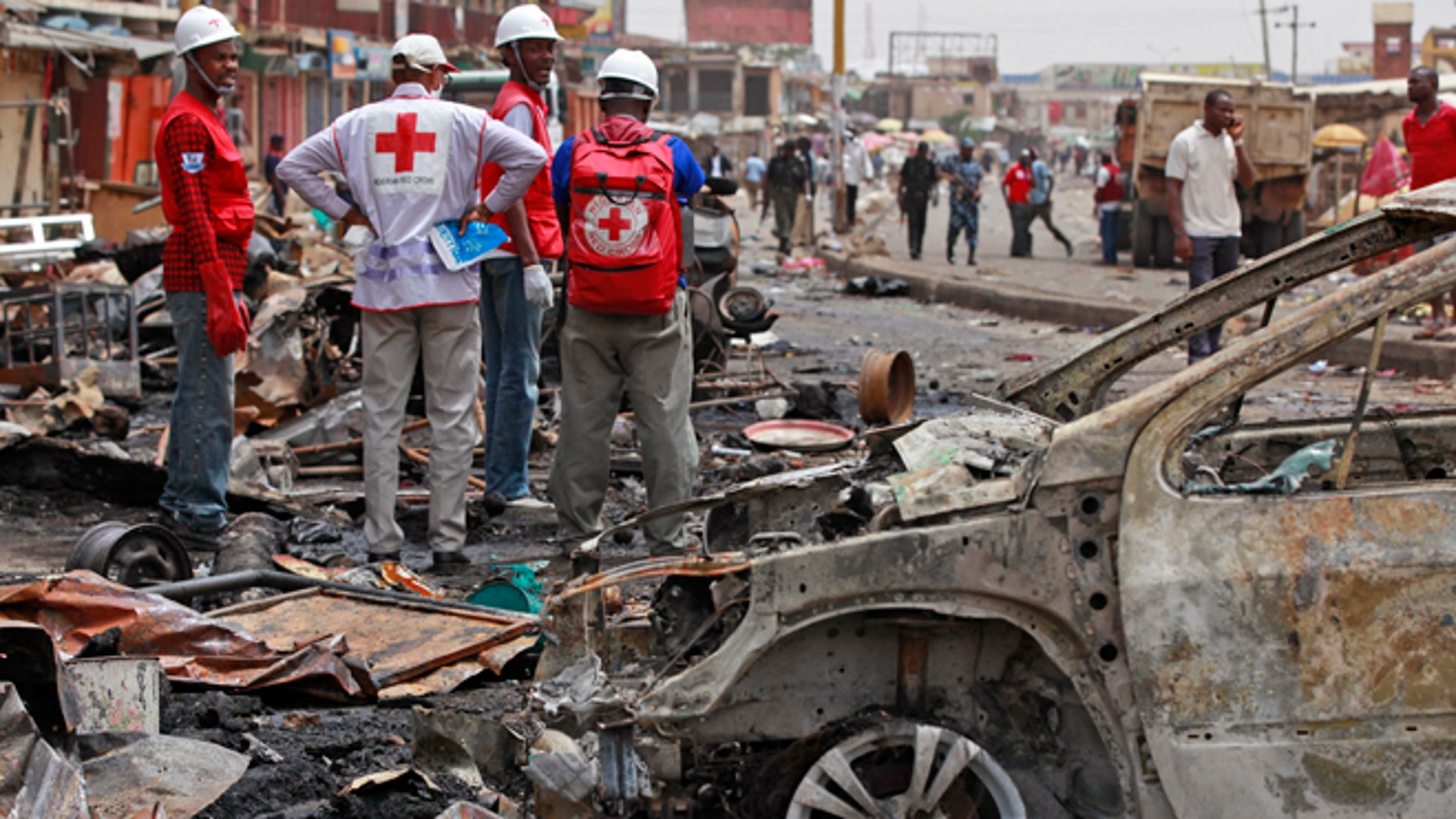 May 21, 2014: Red Cross personnel search for remains at the site of one of a car bomb in Jos, Nigeria.  Boko Haram militants are taking over villages in northeastern Nigeria, killing and terrorizing civilians and political leaders. (AP/Sunday Alamba/File)