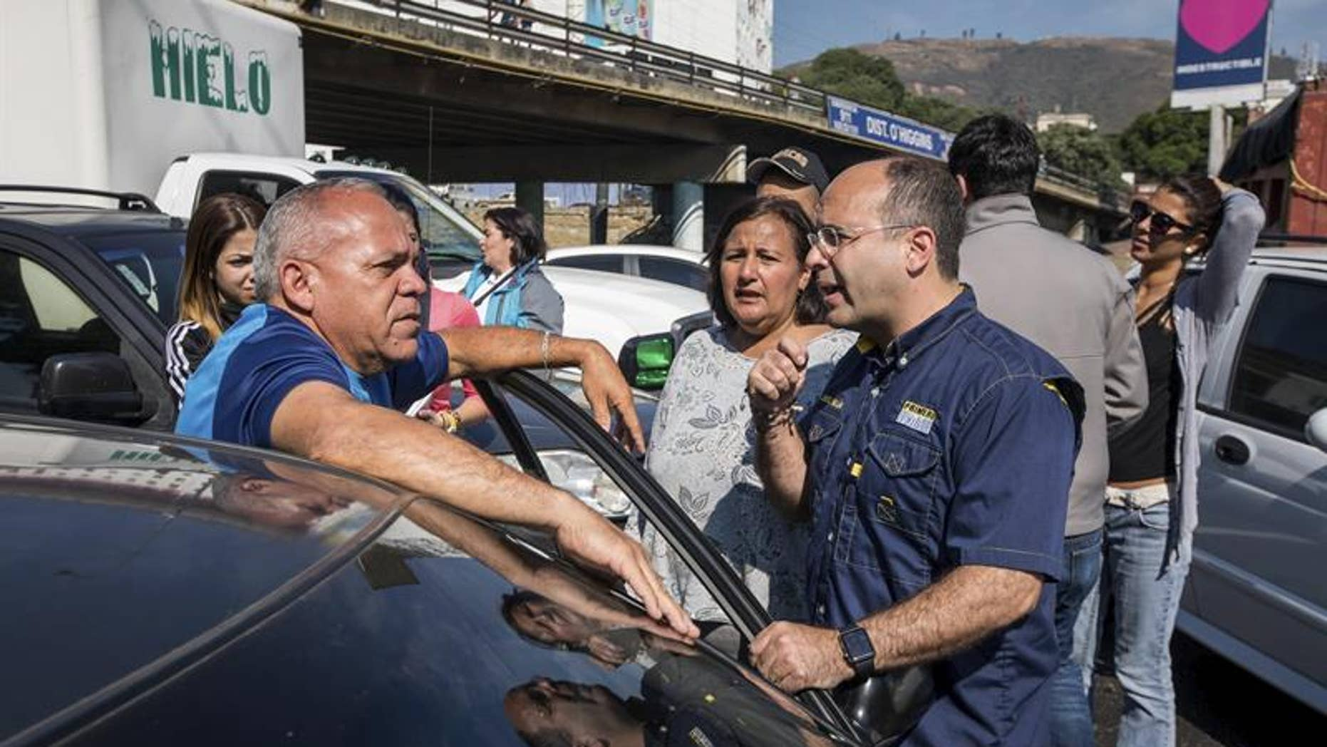 Venezuelan opposition lawmakers and their supporters block a Caracas freeway on Feb. 17, 2017.