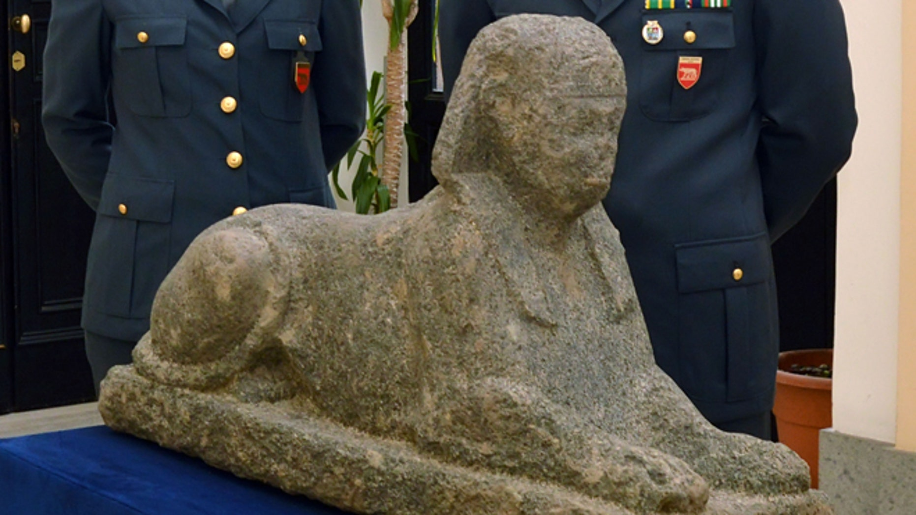 This photo provided Thursday, Dec. 6, 2012 by the Italian Finance police shows an Egyptian sphinx confiscated by police from a greenhouse near Rome.