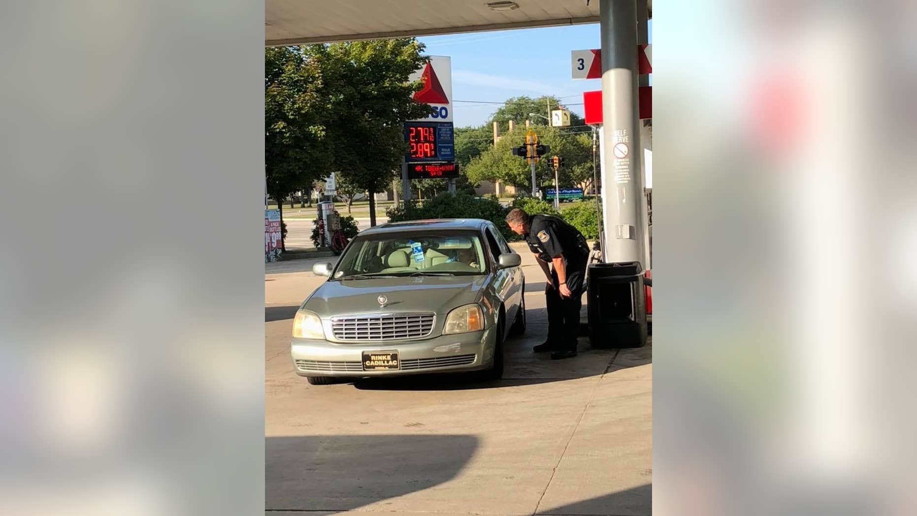 A now-viral Facebook post describes how a police officer helped out an elderly woman at a gas station last week.