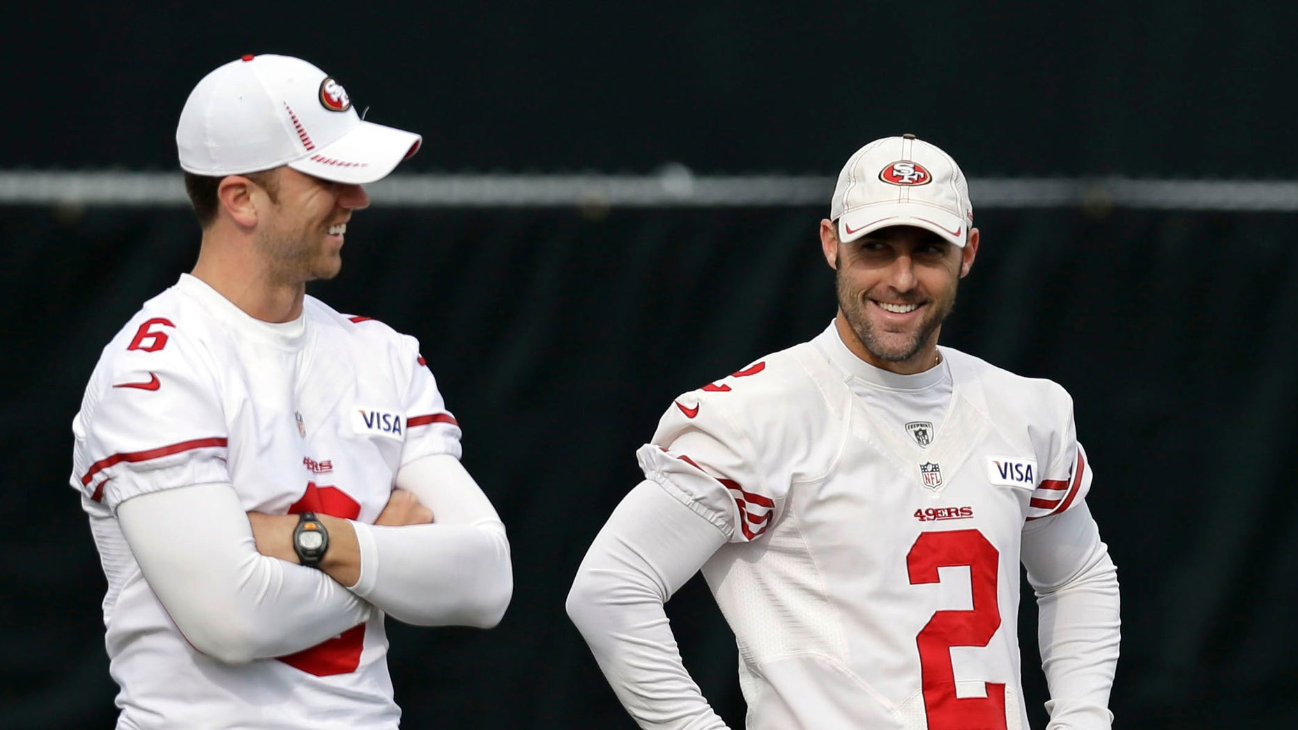 San Francisco 49ers place kickers Billy Cundiff, left, and David Akers (2) chat during NFL football practice in Santa Clara, Calif., Wednesday, Jan. 9, 2013. The 49ers host the Green Bay Packers in an NFC divisional playoff game on Saturday. (AP Photo/Marcio Jose Sanchez)