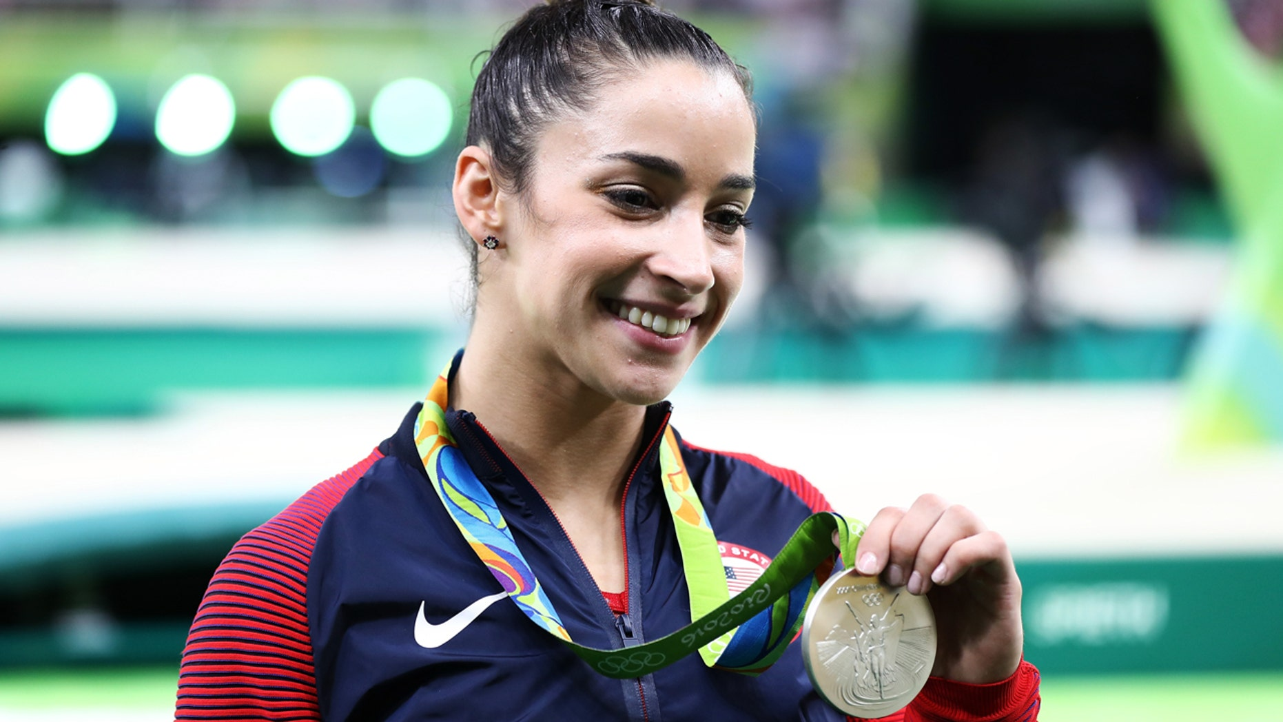 Silver medalist Alexandra Raisman of the United States poses for photographs after the medal ceremony for the Women's Individual All Around on Day 6 of the 2016 Rio Olympics at Rio Olympic Arena on August 11, 2016 in Rio de Janeiro, Brazil.