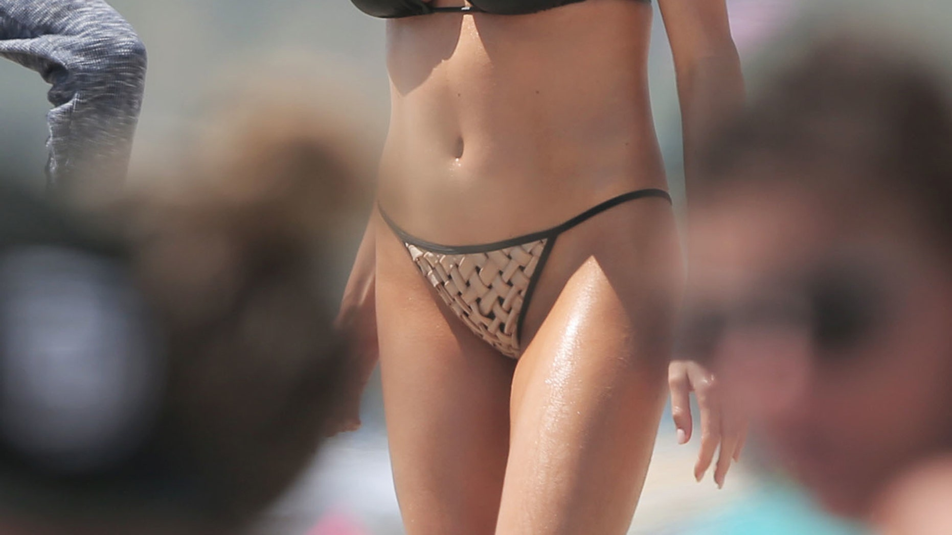 Model Charlotte McKinney displays her curves on the beach in Santa Monica.