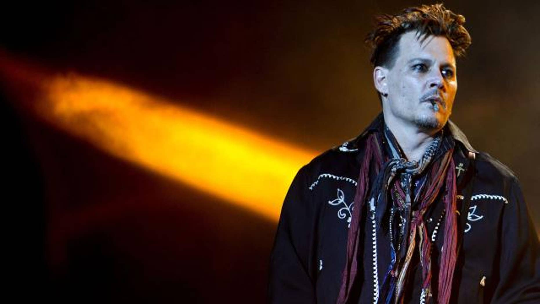 Johnny Depp hits the stage in Portugal.