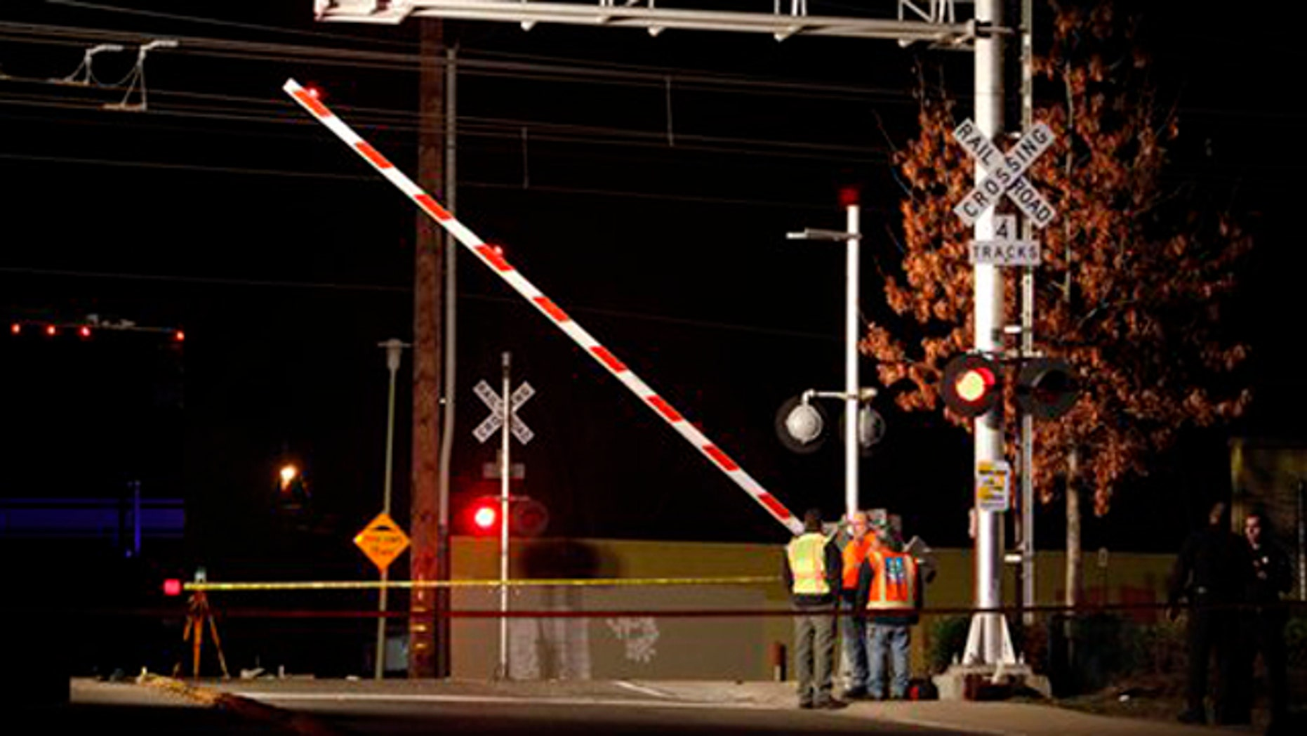 Jan. 28, 2012: Officials test the signals and lights at an intersection where an SUV and Light Rail train collided in Sacramento, Calif.
